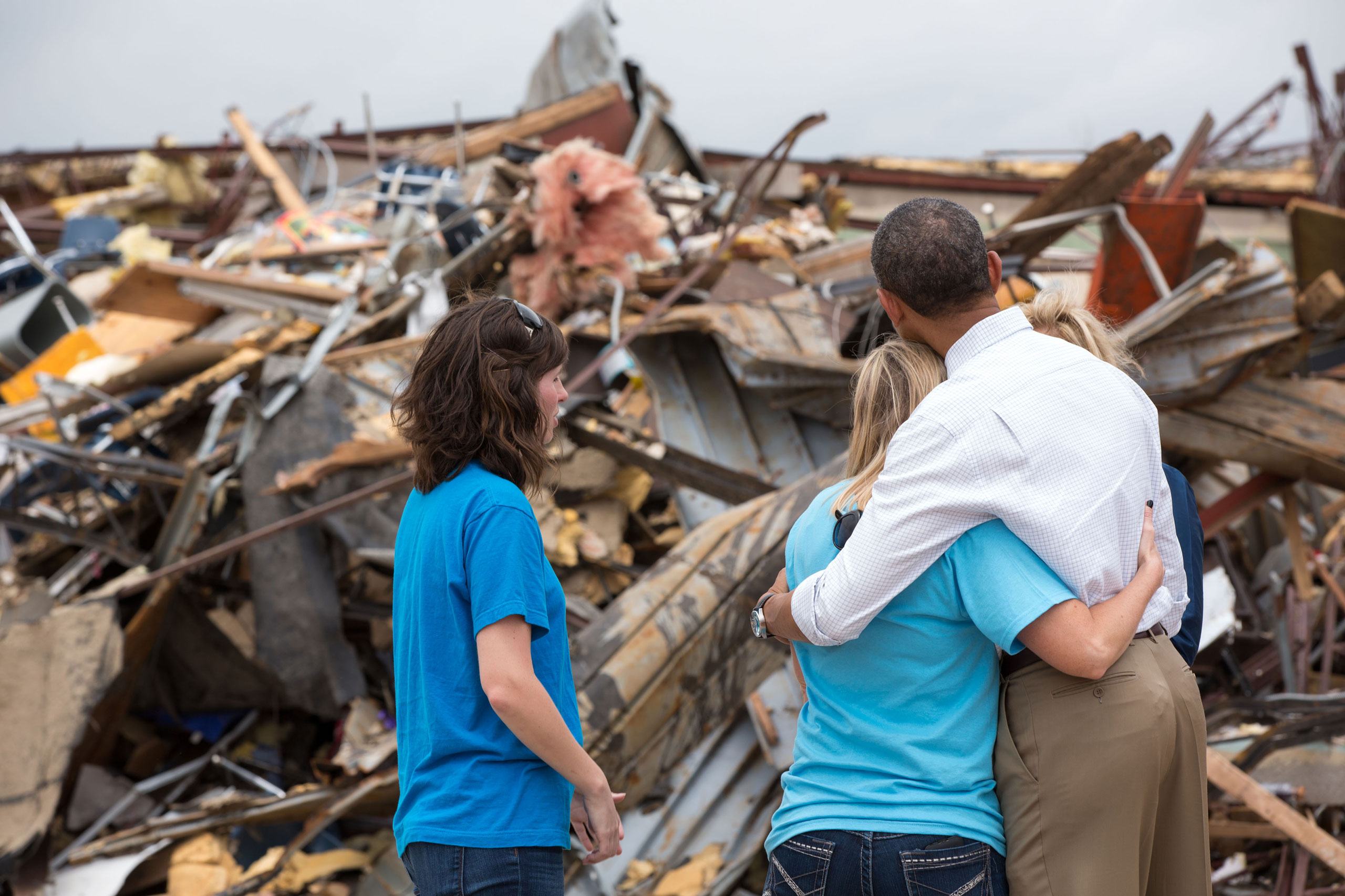 President Barack Obama hugs Amy Simpson, principal of Plaza Towers Elementary School, outside what remains of the school following a tornado in Moore, Okla., May 26, 2013.
