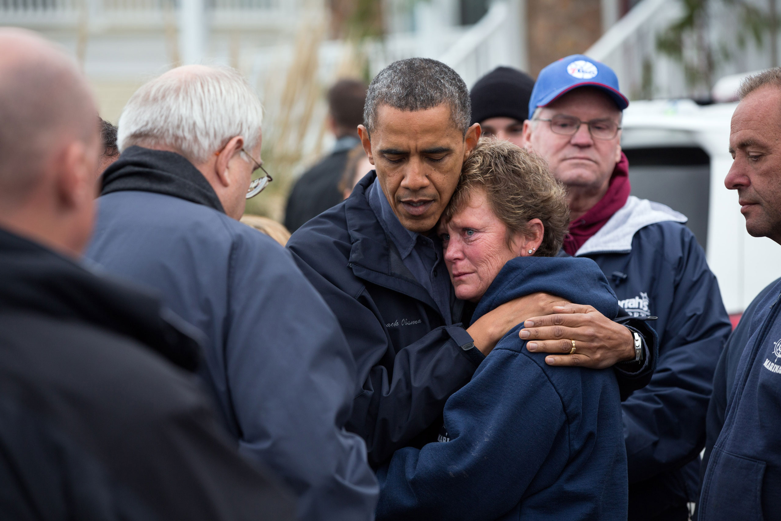 President Barack Obama talks with Donna Vanzant, owner of the North Point Marina in Brigantine, New Jersey, Oct. 31, 2012. The President was surveying damage caused by Hurricane Sandy.