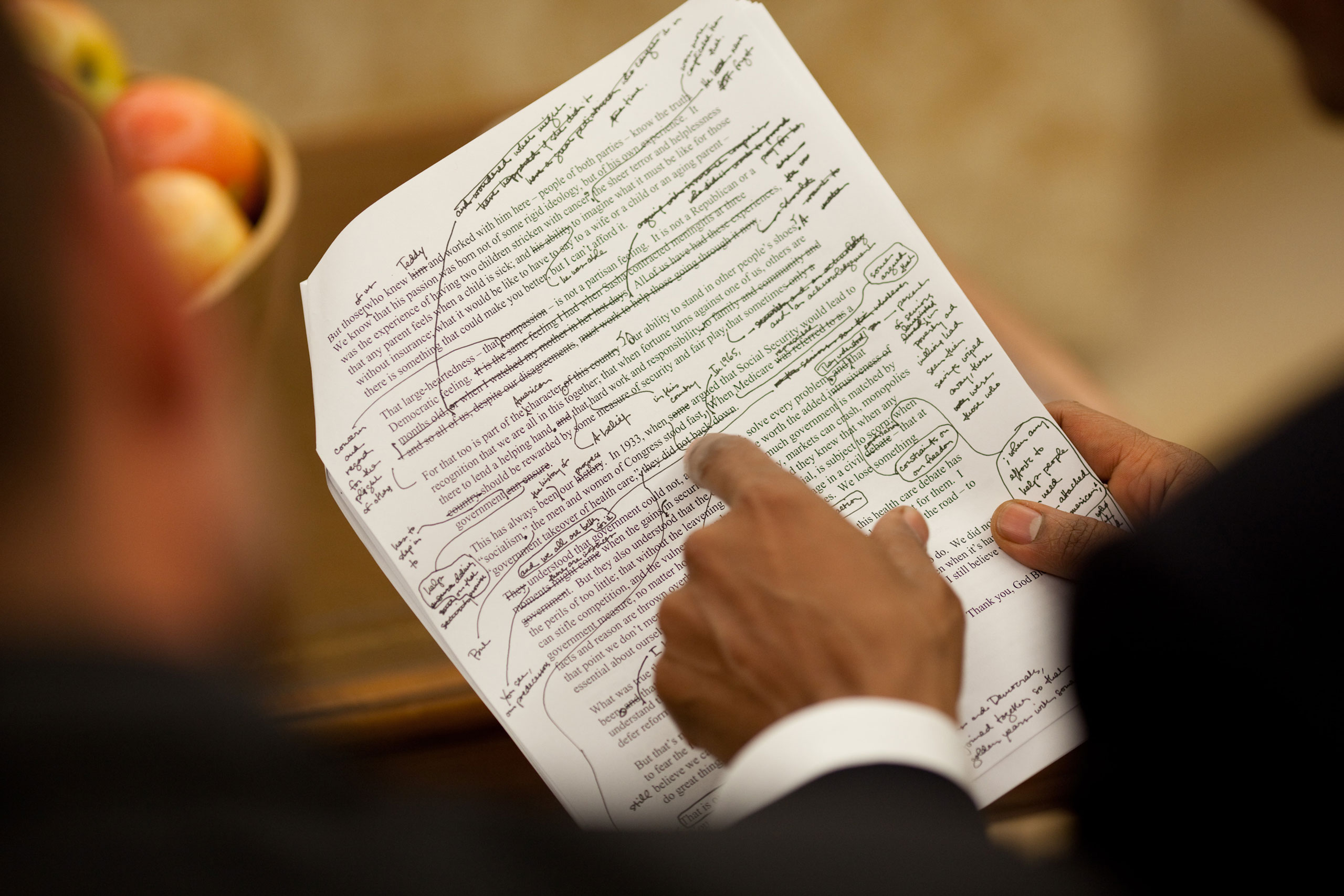 """""""The President works on his health care speech with his chief speechwriter, Jon Favreau, in the Oval Office, Sept. 9, 2009. I noticed his handwritten edits and made this close-up. It's a simple picture but it tells volumes about how involved he is in writing and editing his speeches."""""""