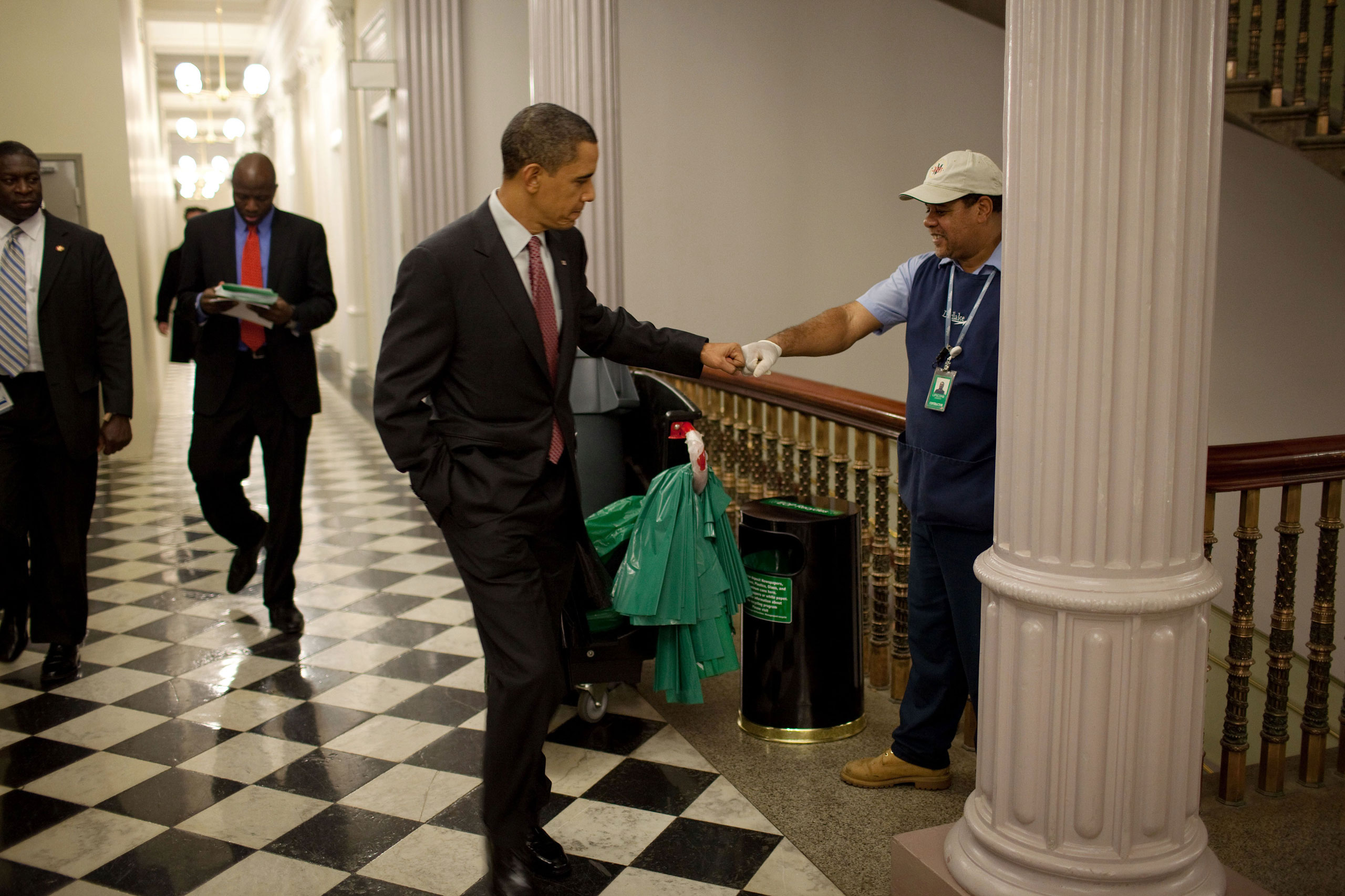 President Barack Obama fist-bumps custodian Lawrence Lipscomb in the Eisenhower Executive Office Building following the opening session of the White House Forum on Jobs and Economic Growth, Dec. 3, 2009.