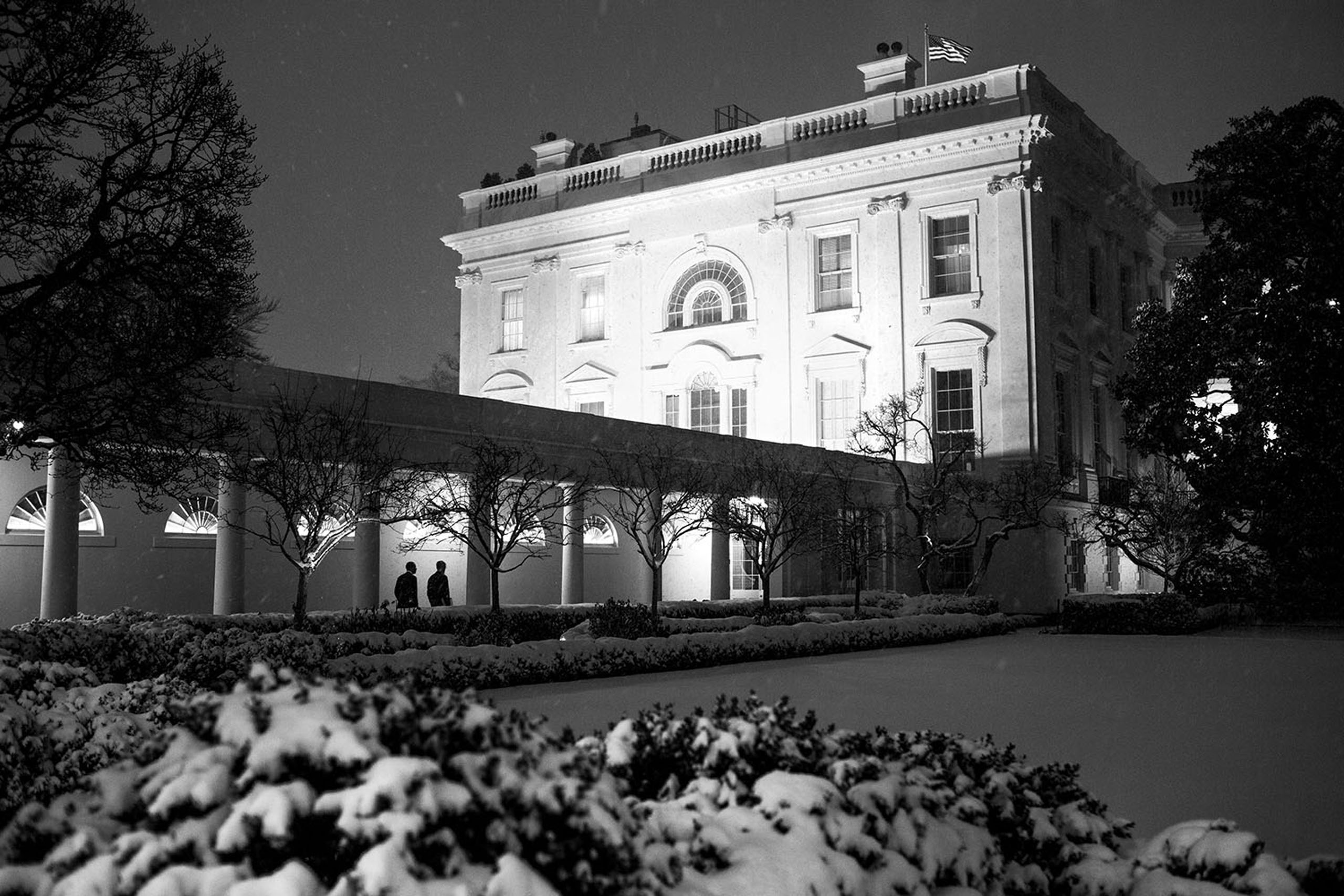 President Barack Obama walks with Chief of Staff Denis McDonough after a day of meetings in the West Wing of the White House, Jan. 21, 2014.