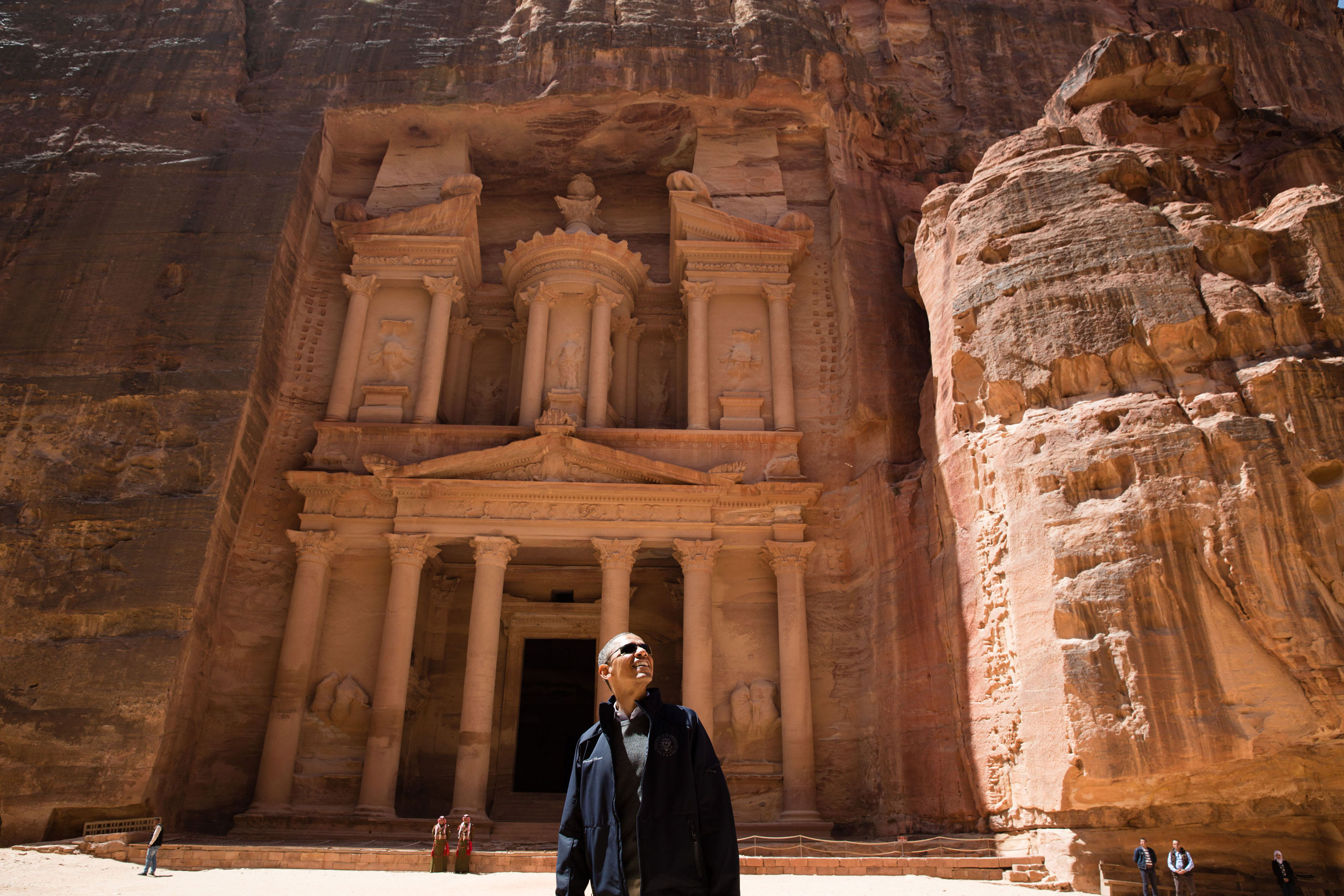 President Barack Obama views the area near the Treasury during a walking tour of the ancient city of Petra in Jordan, March 23, 2013.