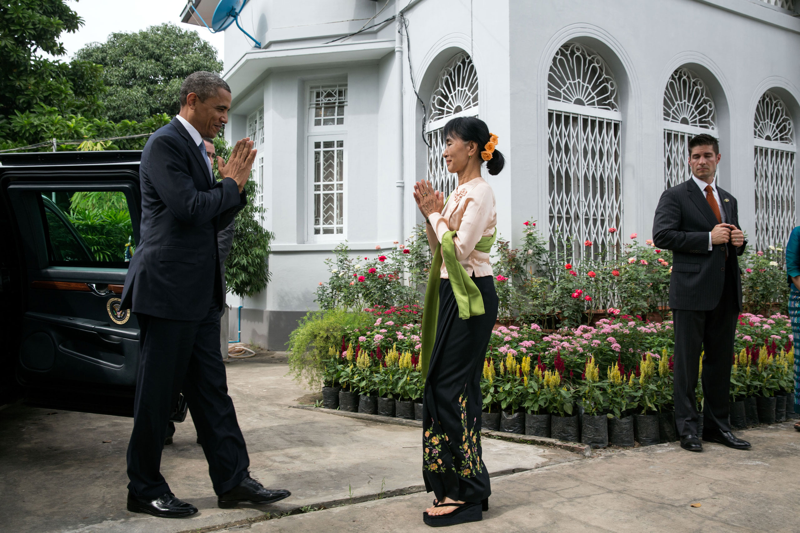 President Barack Obama greets Burmese Opposition Leader Aung San Suu Kyi during a visit to her private residence in Rangoon, Burma, Nov. 19, 2012.
