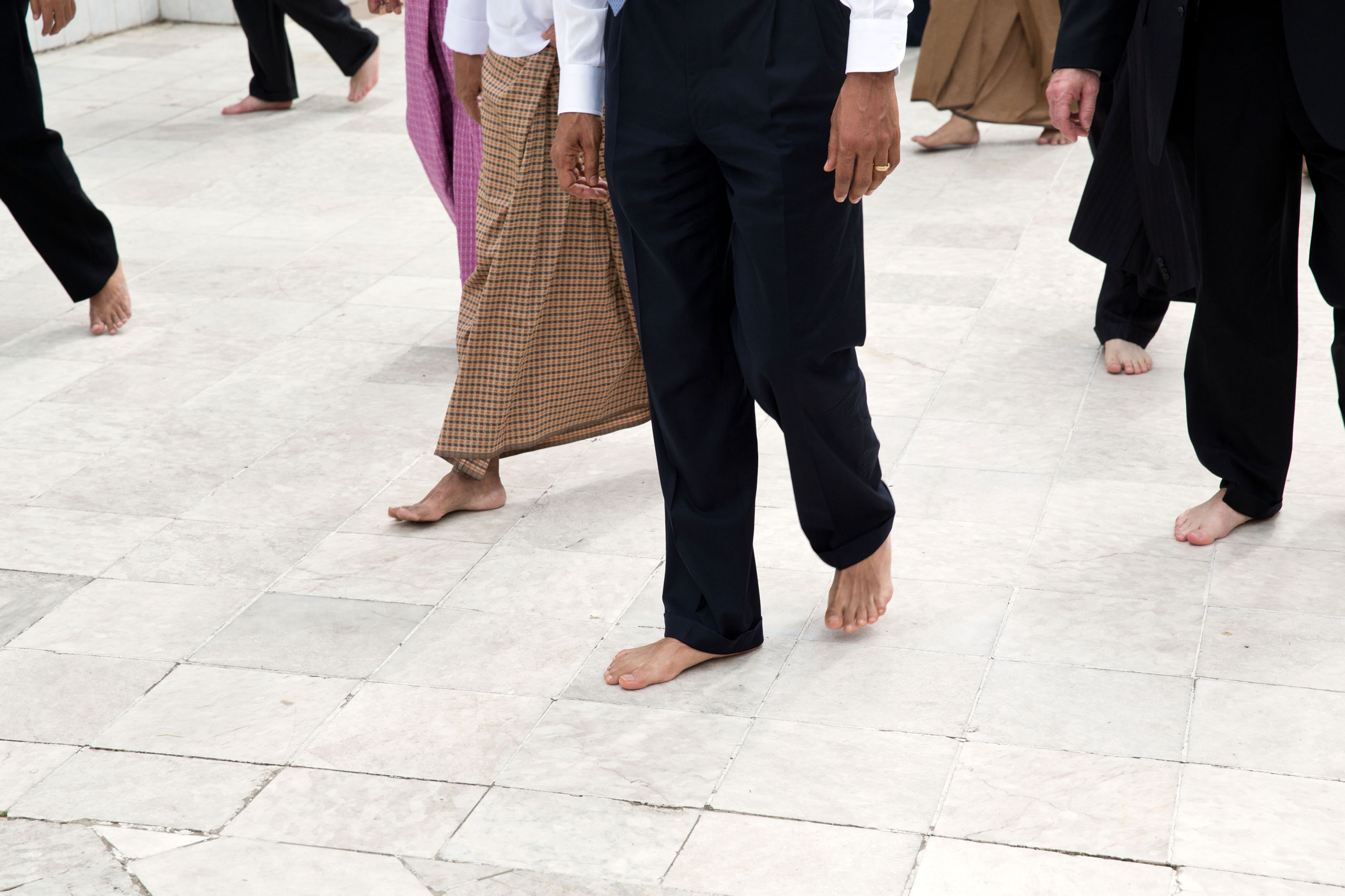 President Barack Obama, guides, and Secret Service agents walk barefoot during a tour of the Shwedagon Pagoda in Rangoon, Burma, Nov. 19, 2012.