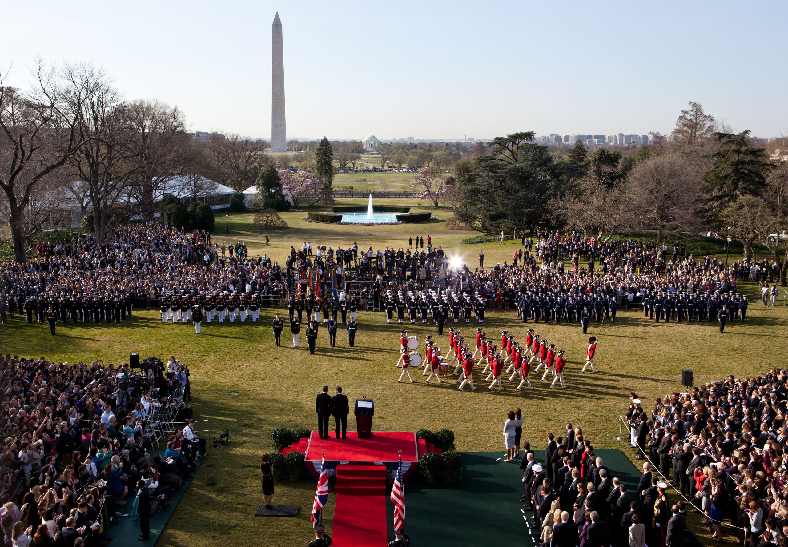President Barack Obama and Prime Minister David Cameron of the United Kingdom watch the U.S. Army Fife and Drum Corps pass during the Official Arrival Ceremony on the South Lawn, March 14, 2012.