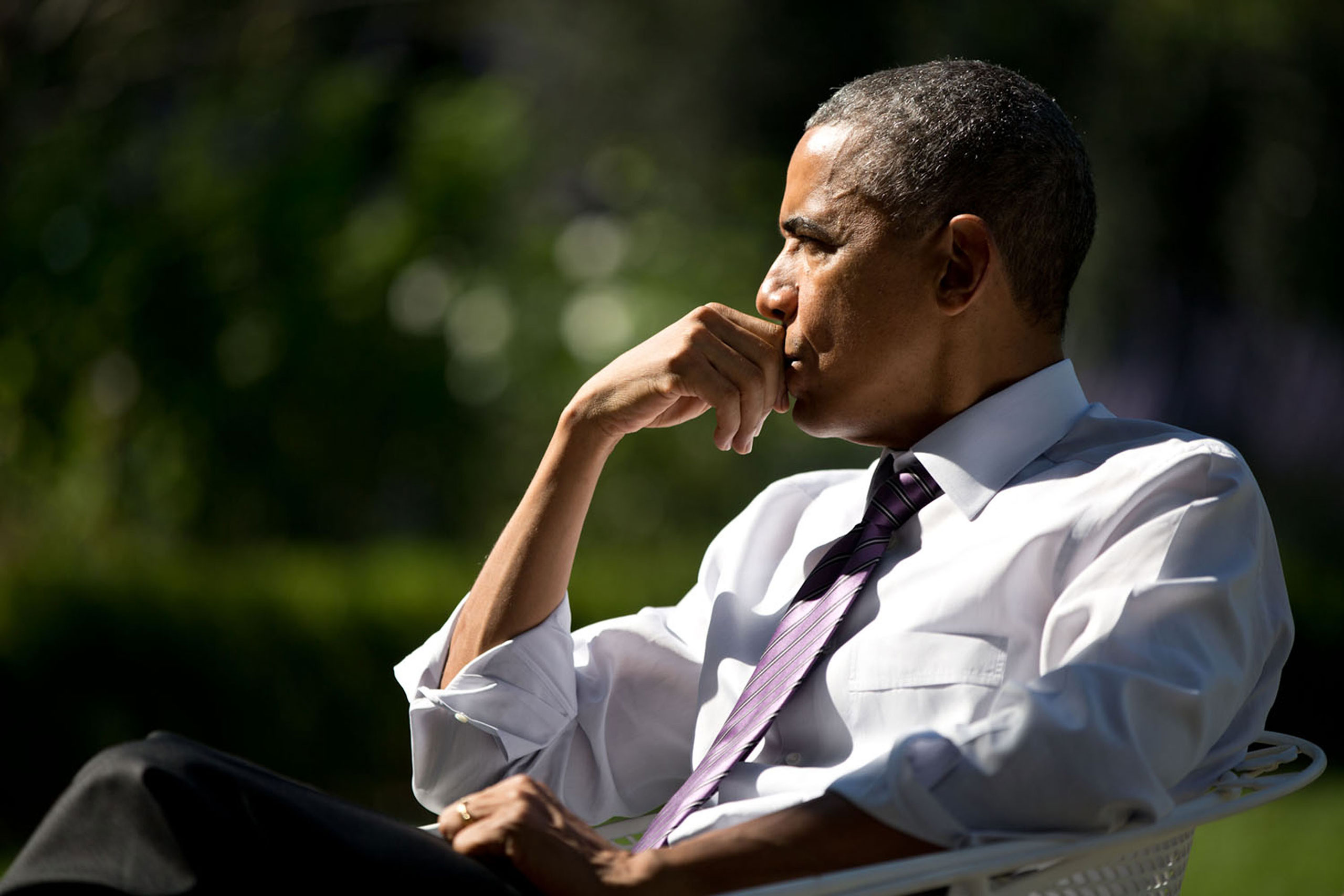 A portrait of the President as he listened during a meeting with staff in the Rose Garden. The meeting was originally scheduled in the Oval Office but the President moved it outside because the weather was so pleasant,  October 8, 2014.