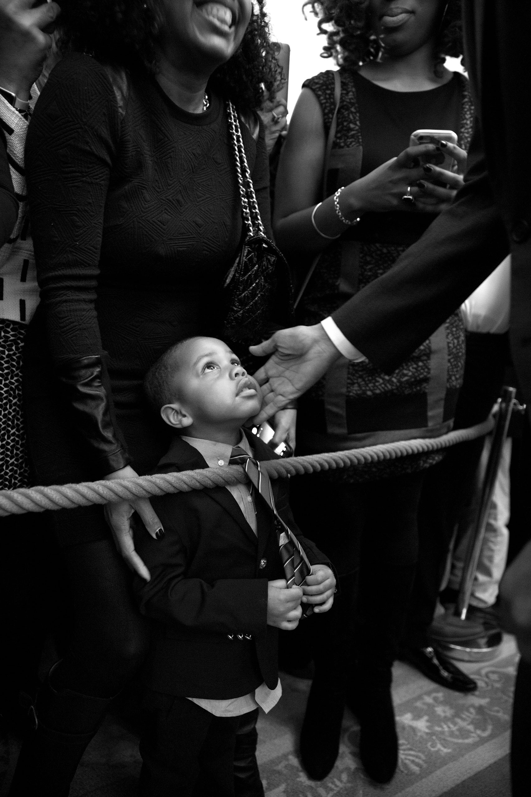 President Barack Obama greets Clark Reynolds, 3, during a reception celebrating African American History Month in the East Room of the White House, Feb. 18, 2016.