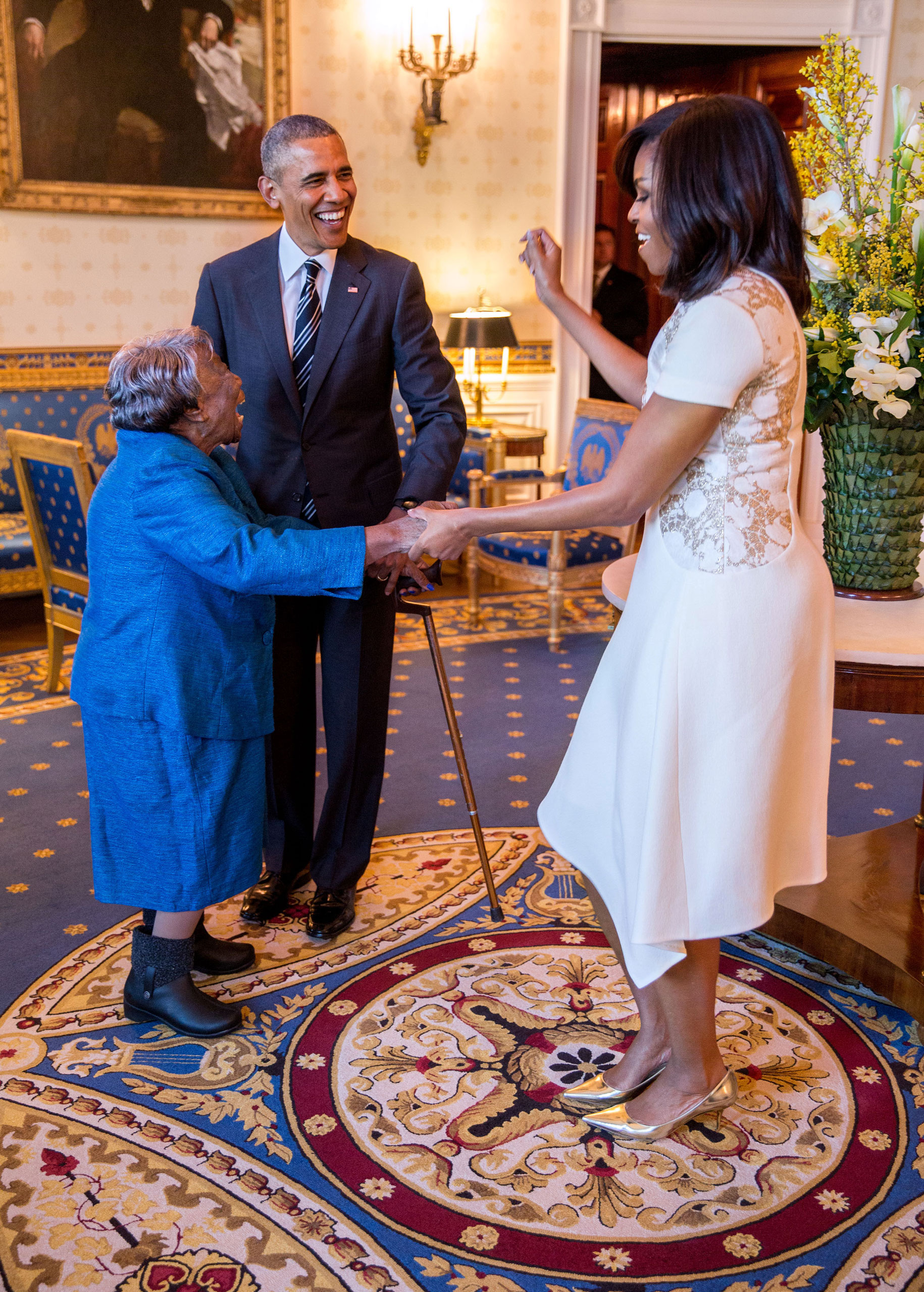 President Barack Obama watches First Lady Michelle Obama dance with 106-Year-Old Virginia McLaurin in the Blue Room of the White House prior to a reception celebrating African American History Month, Feb. 18, 2016.