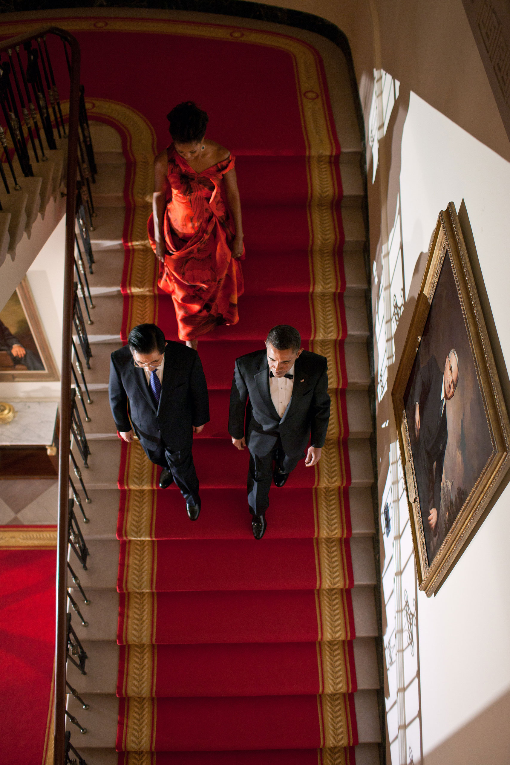 The President, the First Lady and President Hu Jintao of China descend the Grand Staircase of the White House before a formal State Dinner, Jan. 19, 2011.