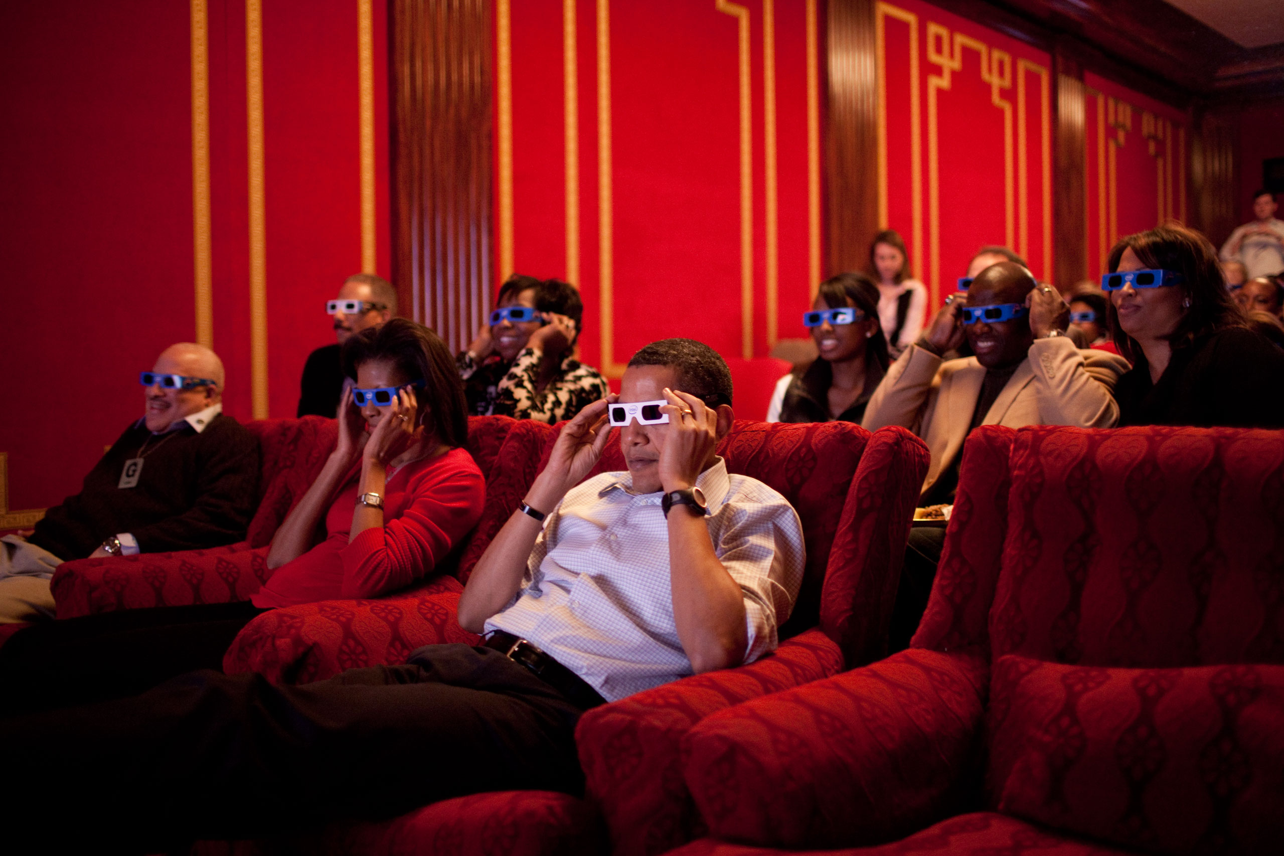 The President and First Lady, along with friends and family, watch a 3D commercial during the Super Bowl, Feb. 1, 2009.