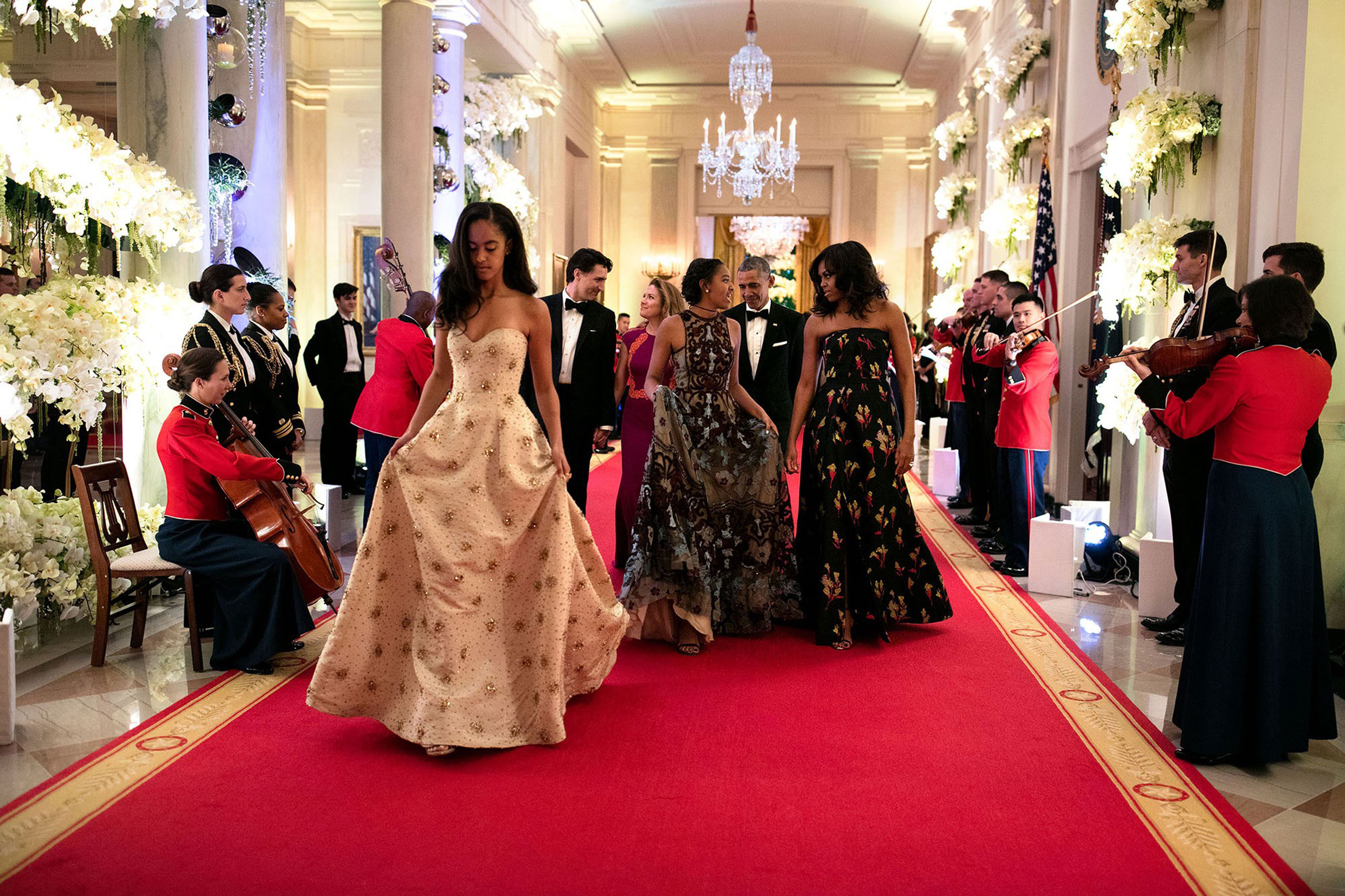 """""""What an honor to watch these girls grow up. Malia, foreground, and Sasha were both invited guests for the State Dinner in honor of Prime Minister Justin Trudeau of Canada and Mrs. Sophie Grégoire-Trudeau. Following the actual sit-down dinner in the East Room, they made their way down the Great Hall to the State Dining Room for the musical entertainment, March 10, 2016."""""""