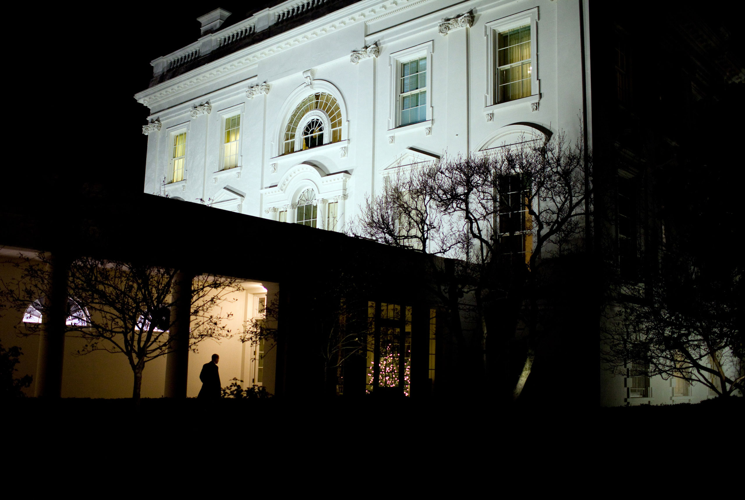 """""""President Obama heads along the White House colonnade to the residence after leaving the Oval Office for the day,  Dec. 3, 2009."""