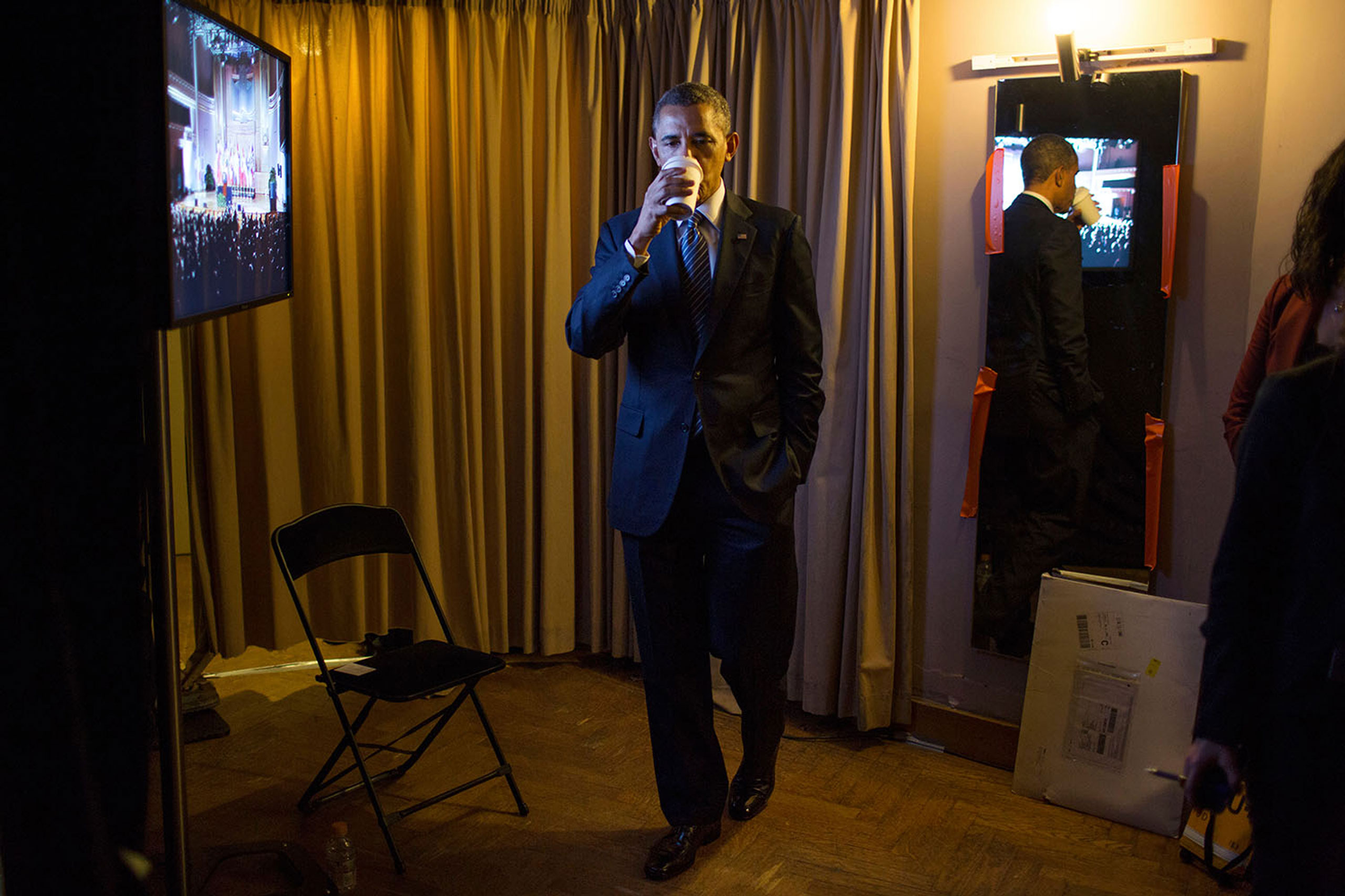 President Barack Obama sips hot tea backstage before he delivers remarks at the Palais Des Beaux Arts in Brussels, Belgium, March 26, 2014.