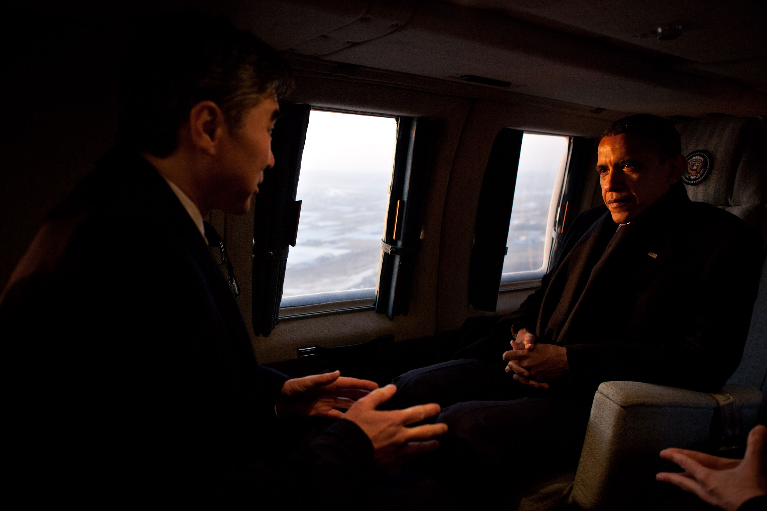 President Barack Obama talks with Sung Kim, U.S. Ambassador to Republic of Korea, aboard Marine One during an early morning flight from Osan Air Base to the landing zone at U.S. Army Garrison Yongsan in Seoul, Republic of Korea, March 25, 2012.