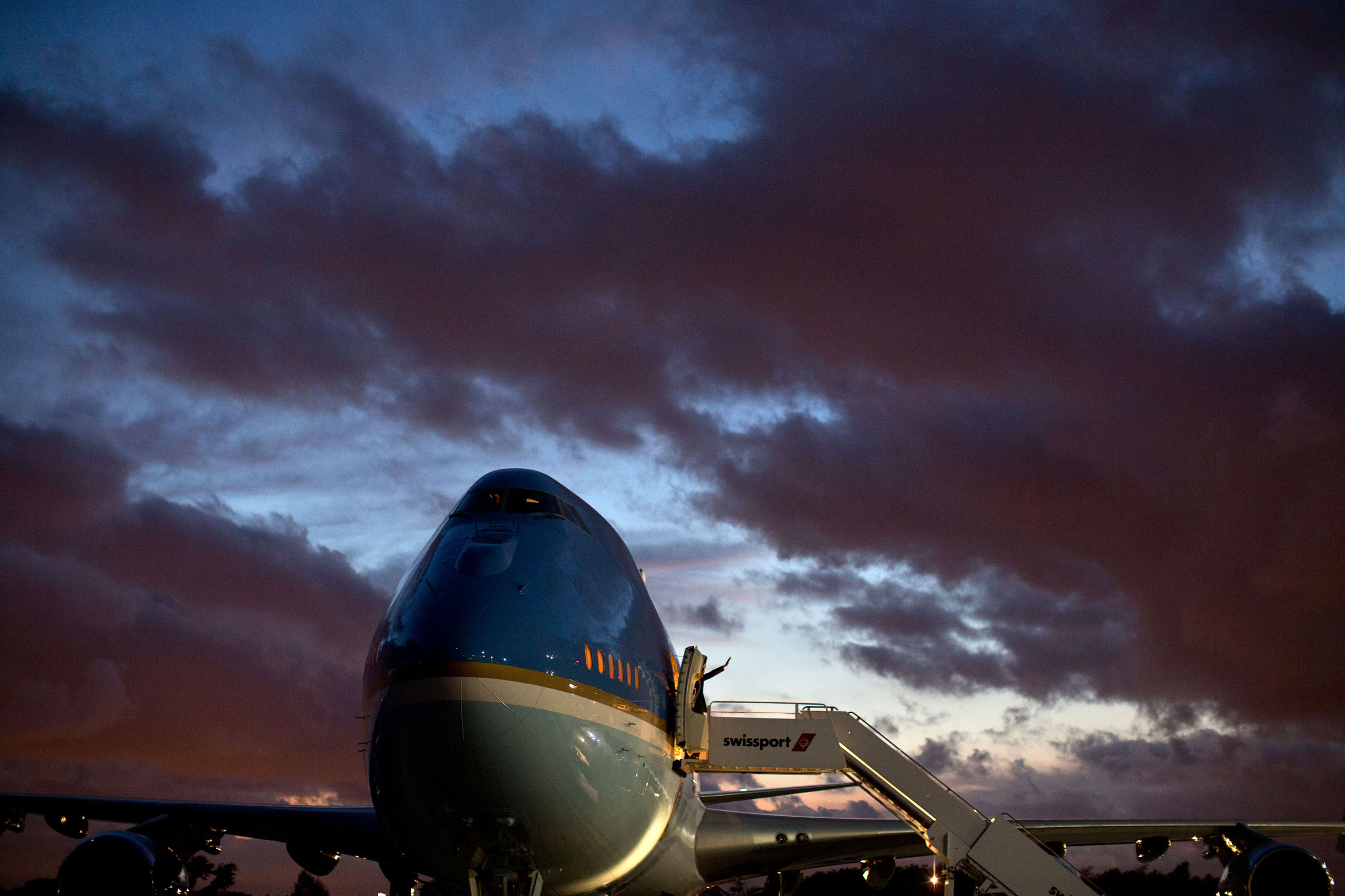 President Barack Obama waves as he boards Air Force One at John F. Kennedy International Airport in New York, N.Y., July 30, 2012.