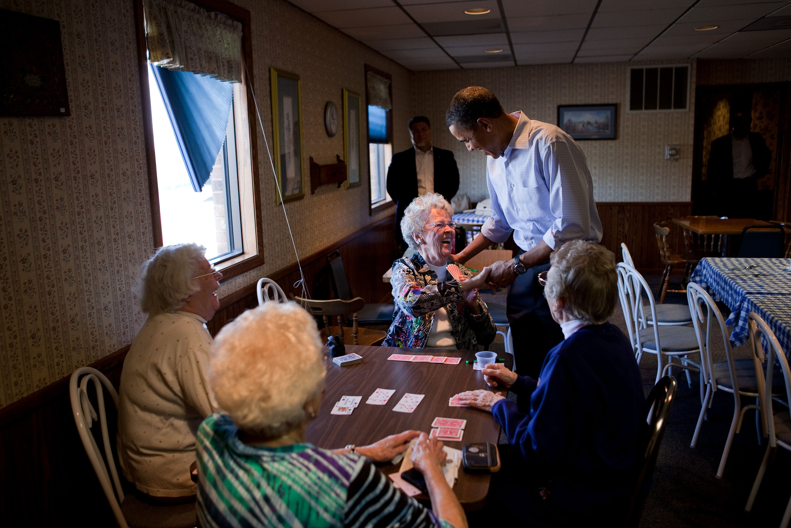 President Barack Obama visits with patrons at Jerry's Family Restaurant in Mount Pleasant, Iowa, April 27, 2010