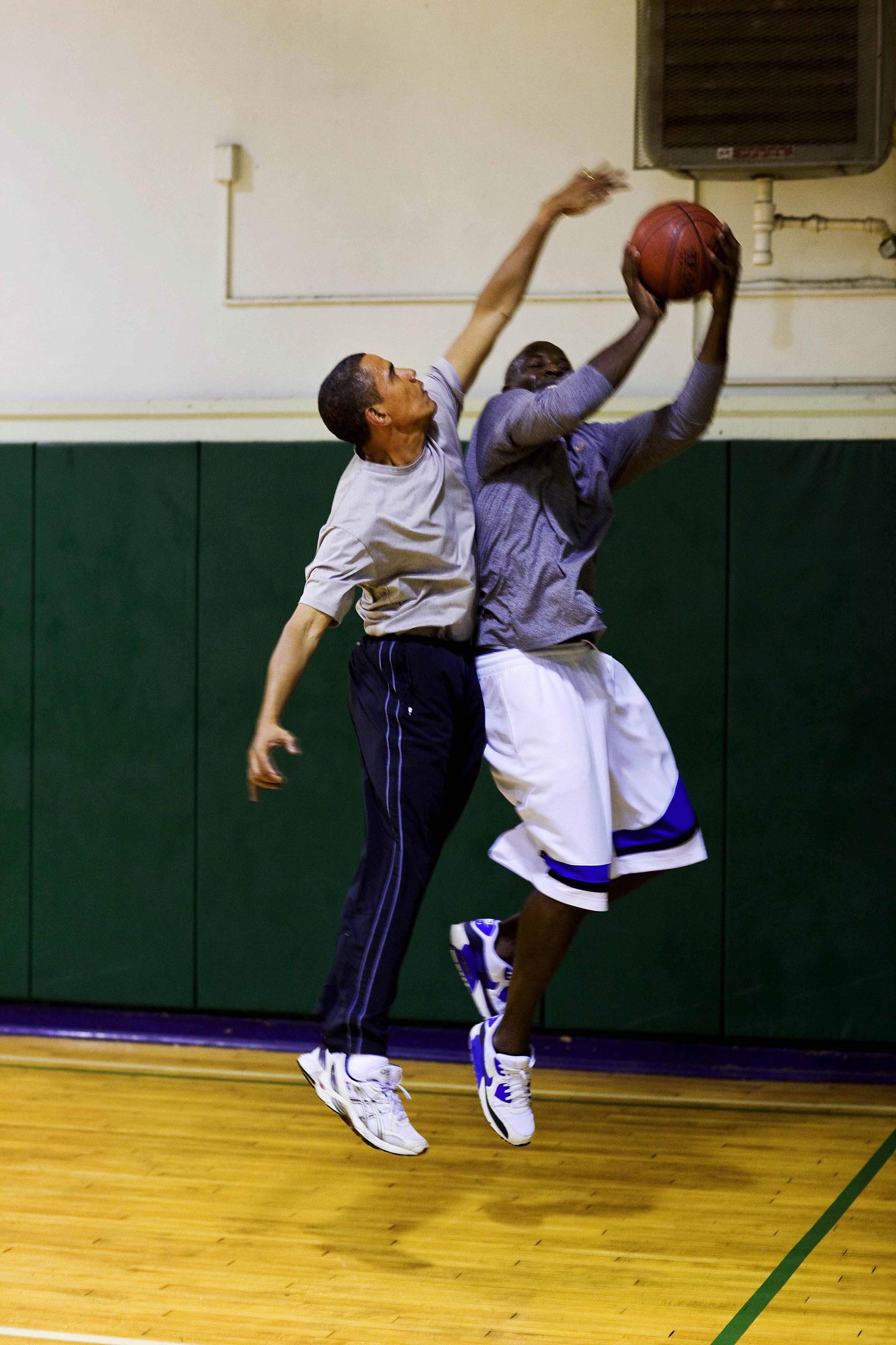 President Barack Obama blocks a shot while playing basketball with personal aide Reggie Love at St Bartholomew's Church in New York City, where the President is attending the United Nations General Assembly, Sept. 23, 2009.