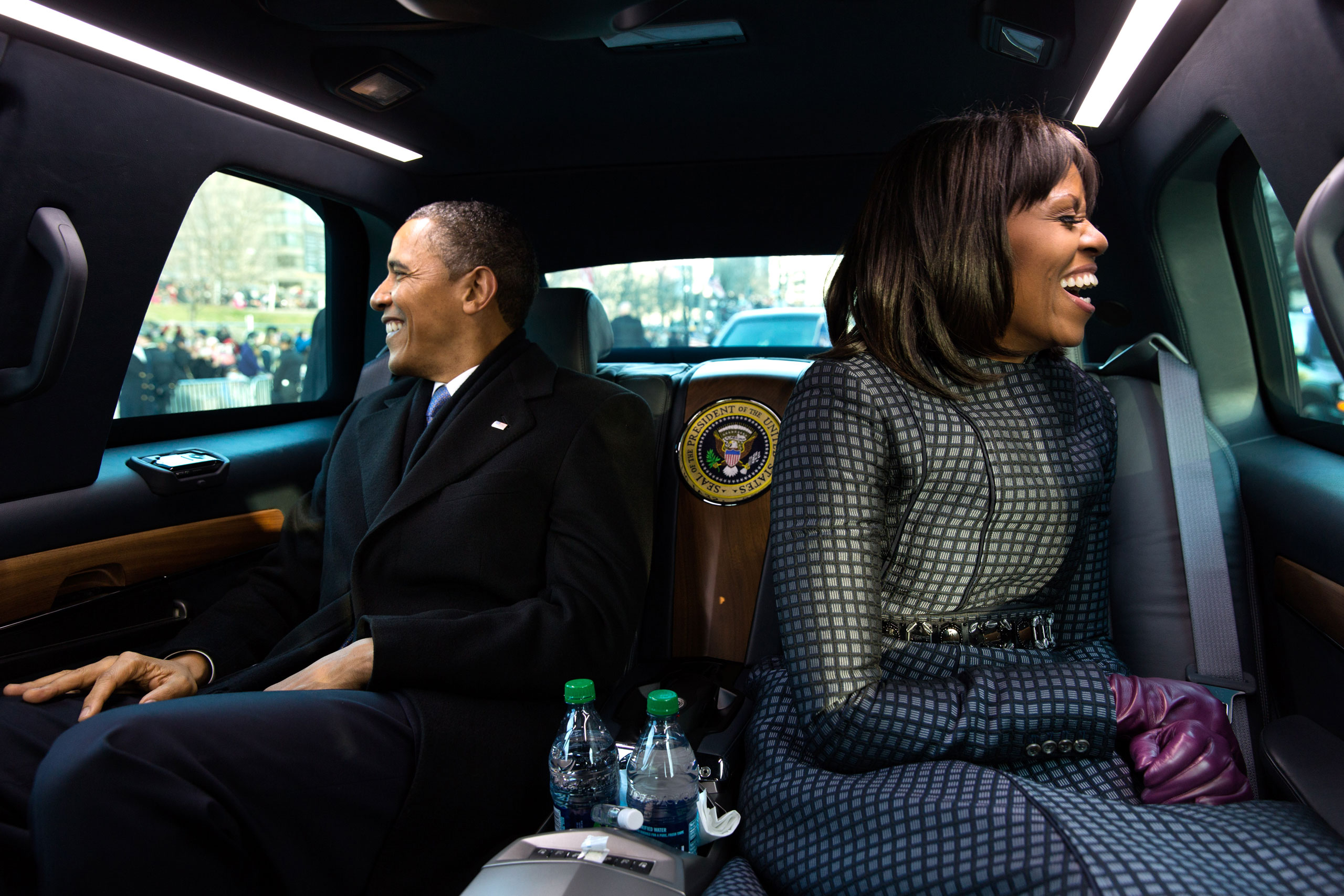 The President and First Lady wave to supporters as they ride in the inaugural parade. I had asked the President if I could ride in the presidential limousine and the President joked, 'But Michelle and I were planning to make out,  Jan. 21, 2013.