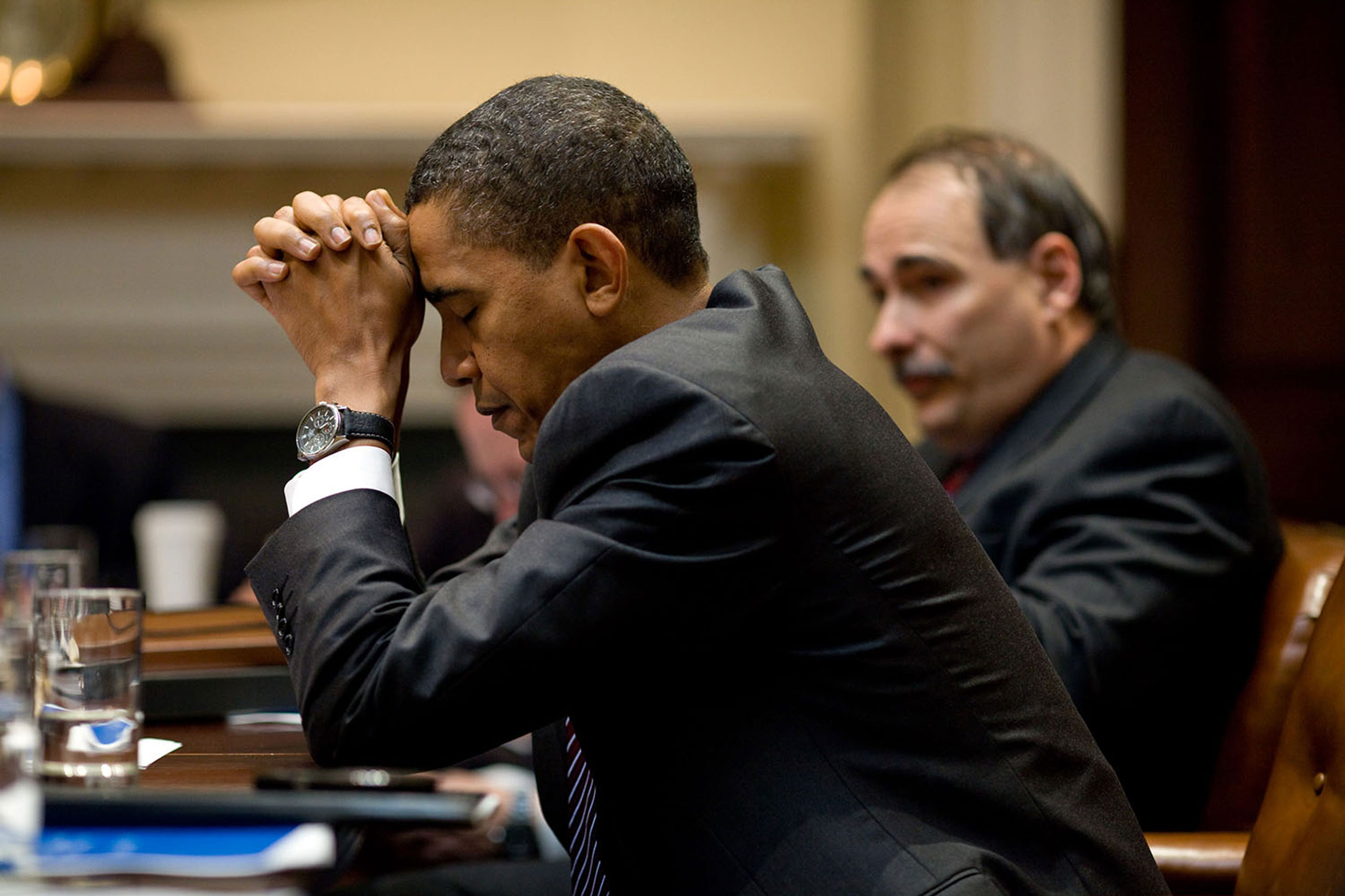"""""""The President appears in deep thought as he and senior advisor David Axelrod listen during a climate change meeting in the Roosevelt Room of the White House. A moment later, he was laughing at a humorous exchange,"""" Oct. 14, 2009."""