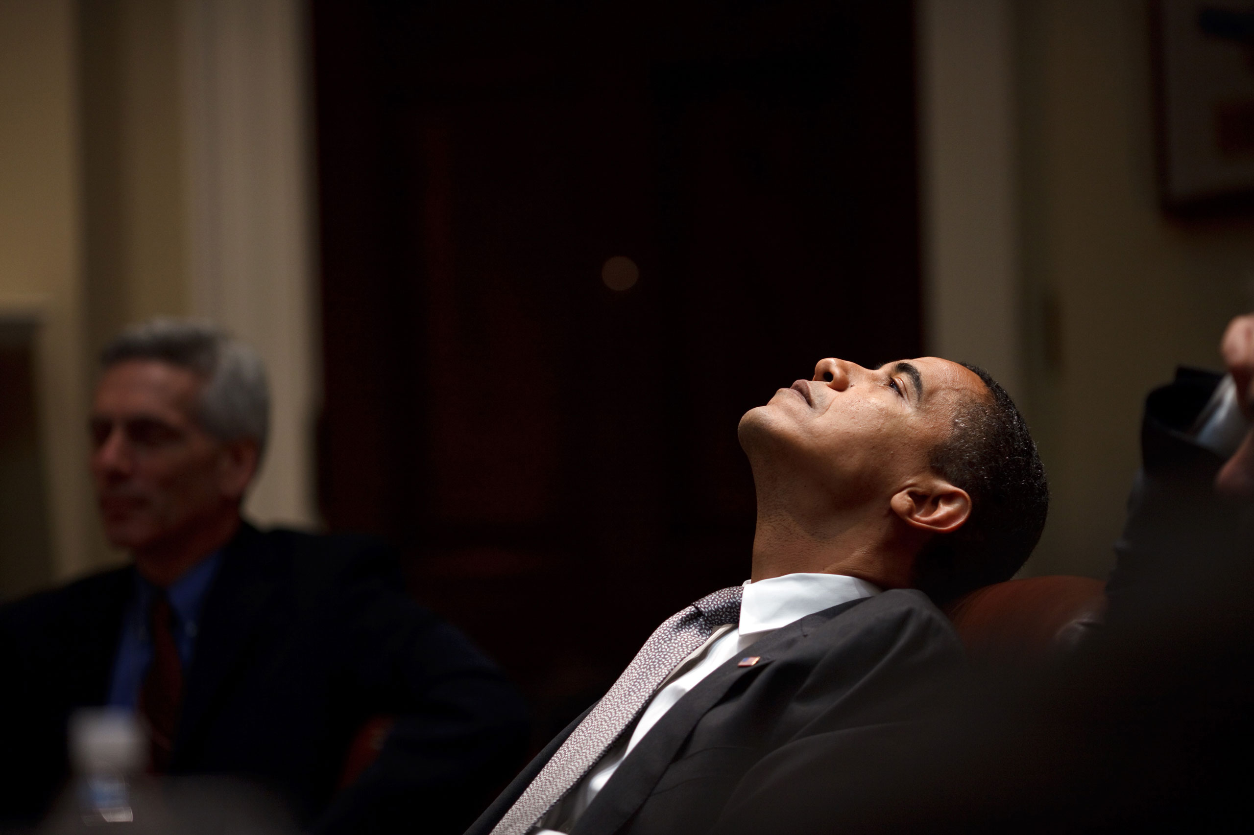 President Obama reflects during an economic meeting in the Roosevelt Room of the White House, Jan. 29, 2009.