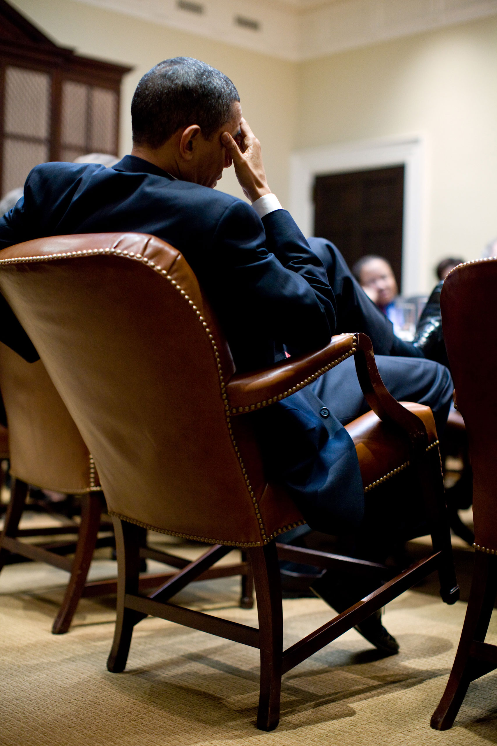 """This was a planning meeting in the Roosevelt Room of the White House. The President was leaning back in his chair, taking in the discussion,"""" Dec. 22, 2009."""