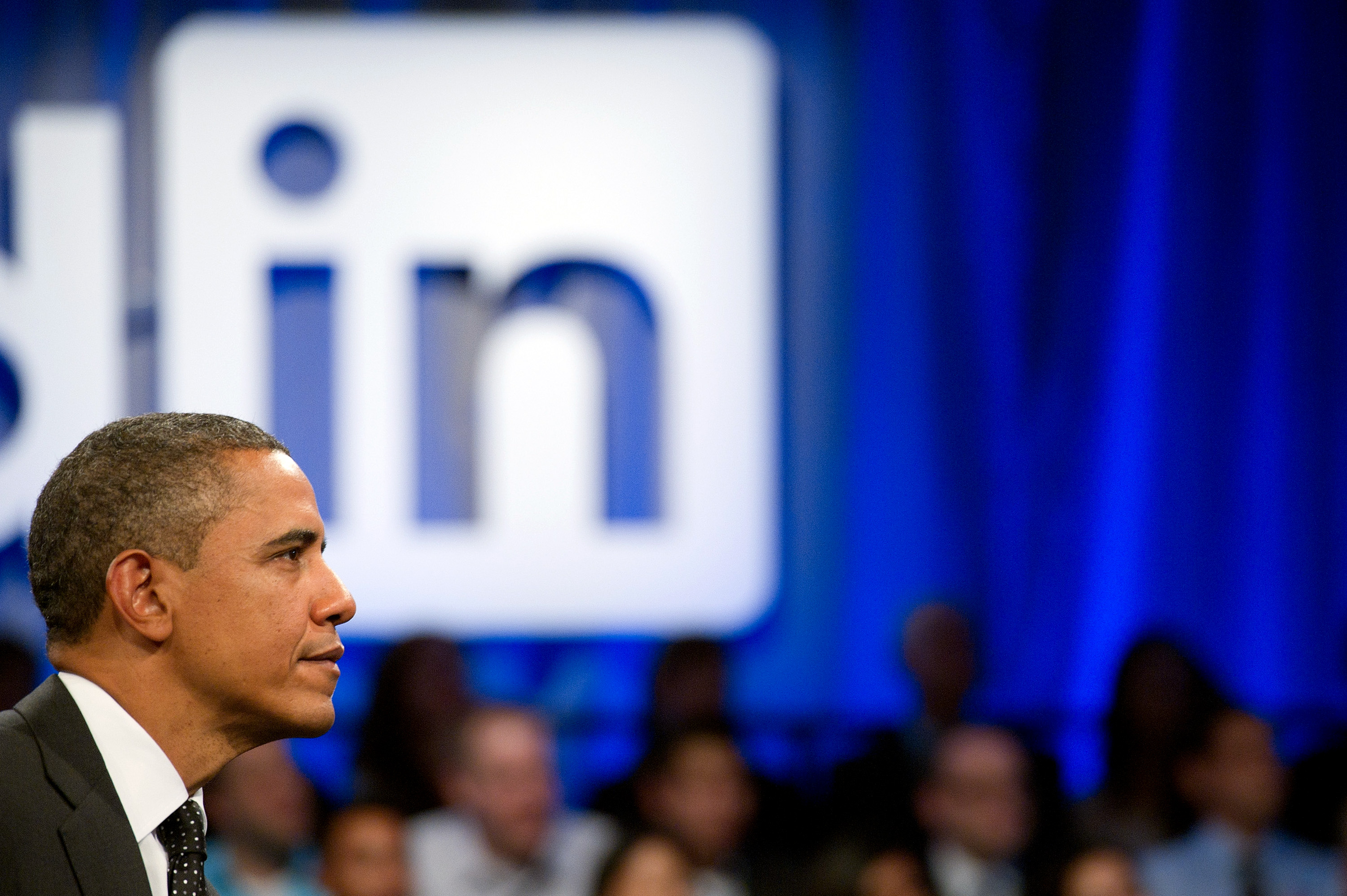 U.S. President Barack Obama listens during a town hall event sponsored by LinkedIn Corp. in Mountain View, California, U.S., on Monday, Sept. 26, 2011.