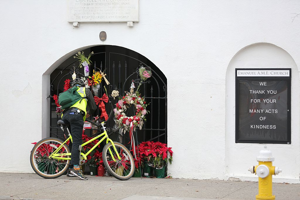 A man stops to observe the makeshift memorial in front of Mother Emanuel AME Church in downtown Charleston, South Carolina on January 4, 2017.