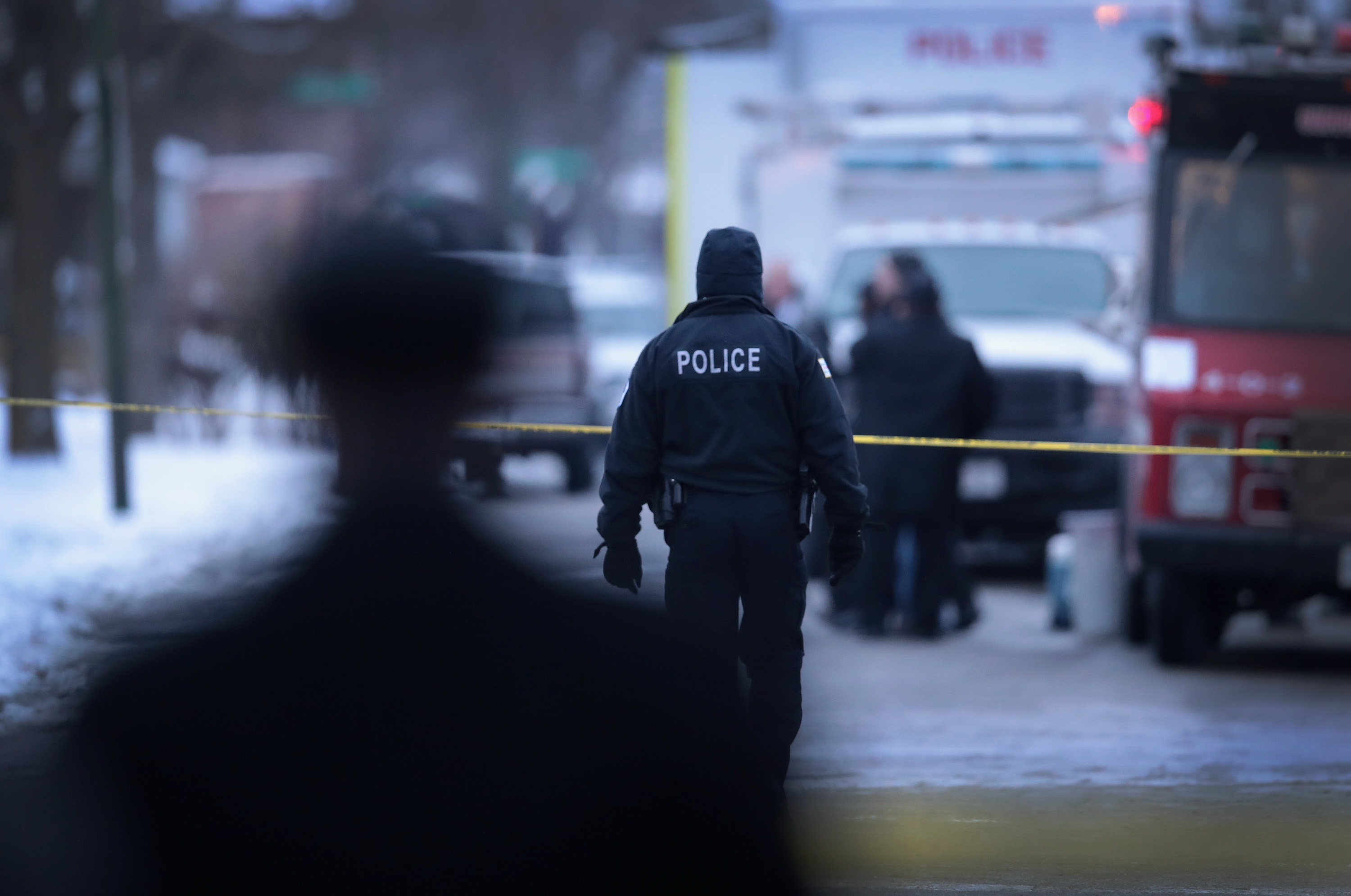 Chicago Police investigate the scene of a quadruple homicide on the city's Southside on Dec. 17, 2016.