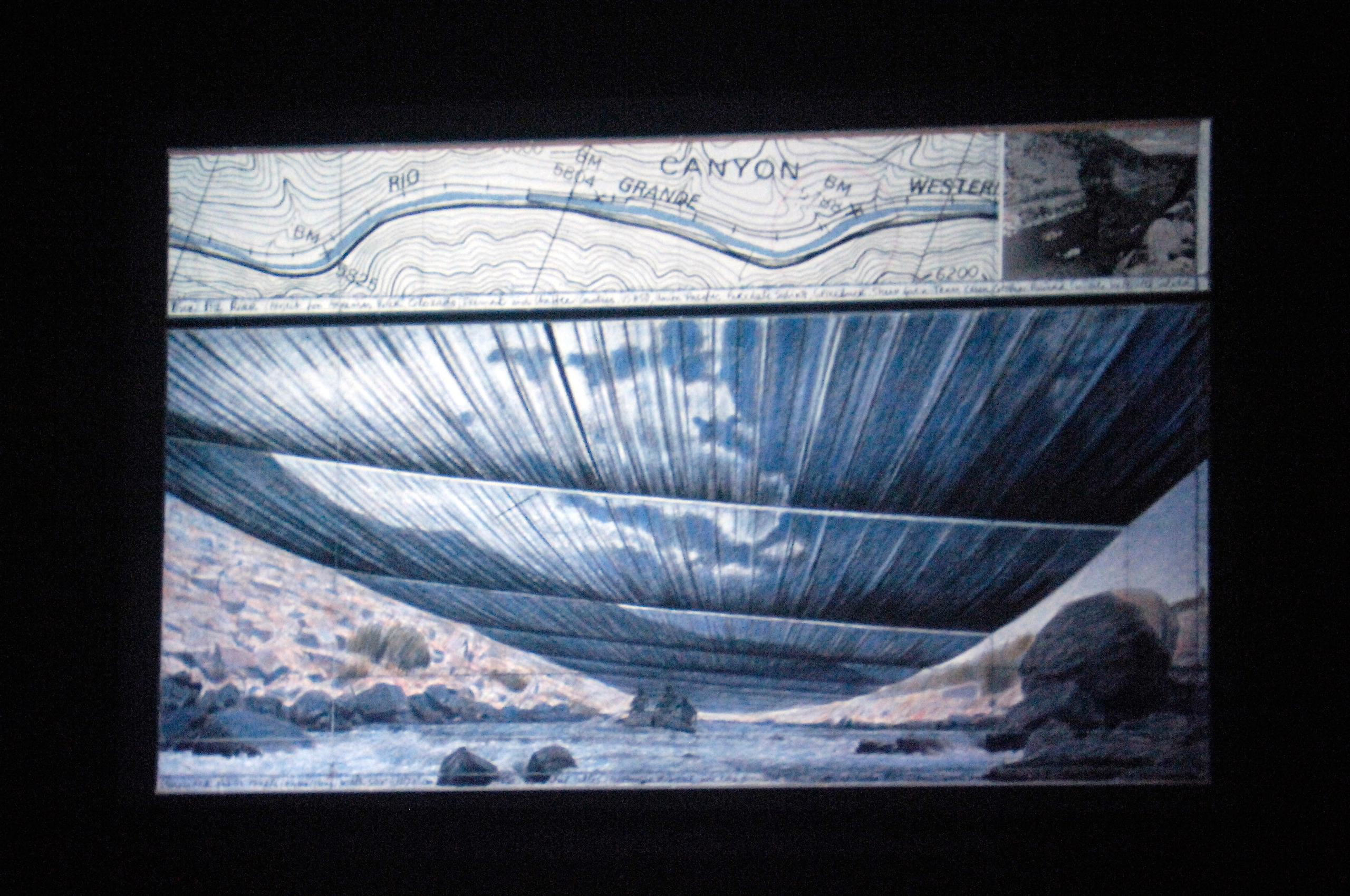 A slideshow of  Over The River  is shown by Christo at an evening lecture sponsored by the Women's Council of the Cleveland Museum of Art in Cleveland on May 23, 2006.