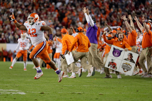 The Clemson Tigers celebrate after quarterback Deshaun Watson #4 (not pictured) threw a 2-yard game-winning touchdown pass to wide receiver Hunter Renfrow #13 (not pictured) during the fourth quarter against the Alabama Crimson Tide to win the 2017 College Football Playoff National Championship Game 35-31 at Raymond James Stadium on January 9, 2017 in Tampa, Florida.