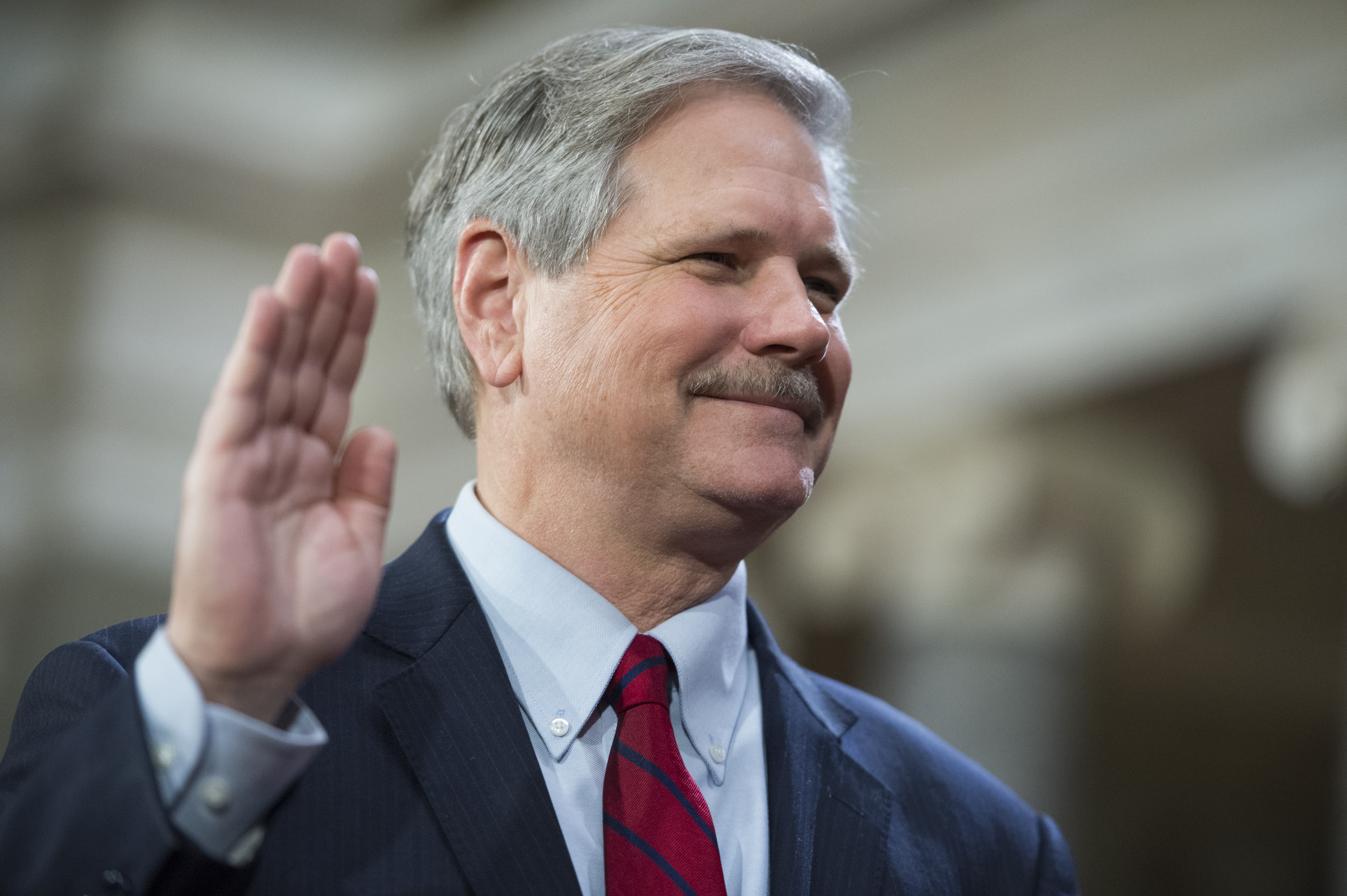 Sen. John Hoeven, R-N.D., is administered an oath by Vice President Joe Biden during a swearing-in ceremony in the Capitol's Old Senate Chamber, January 03, 2016.