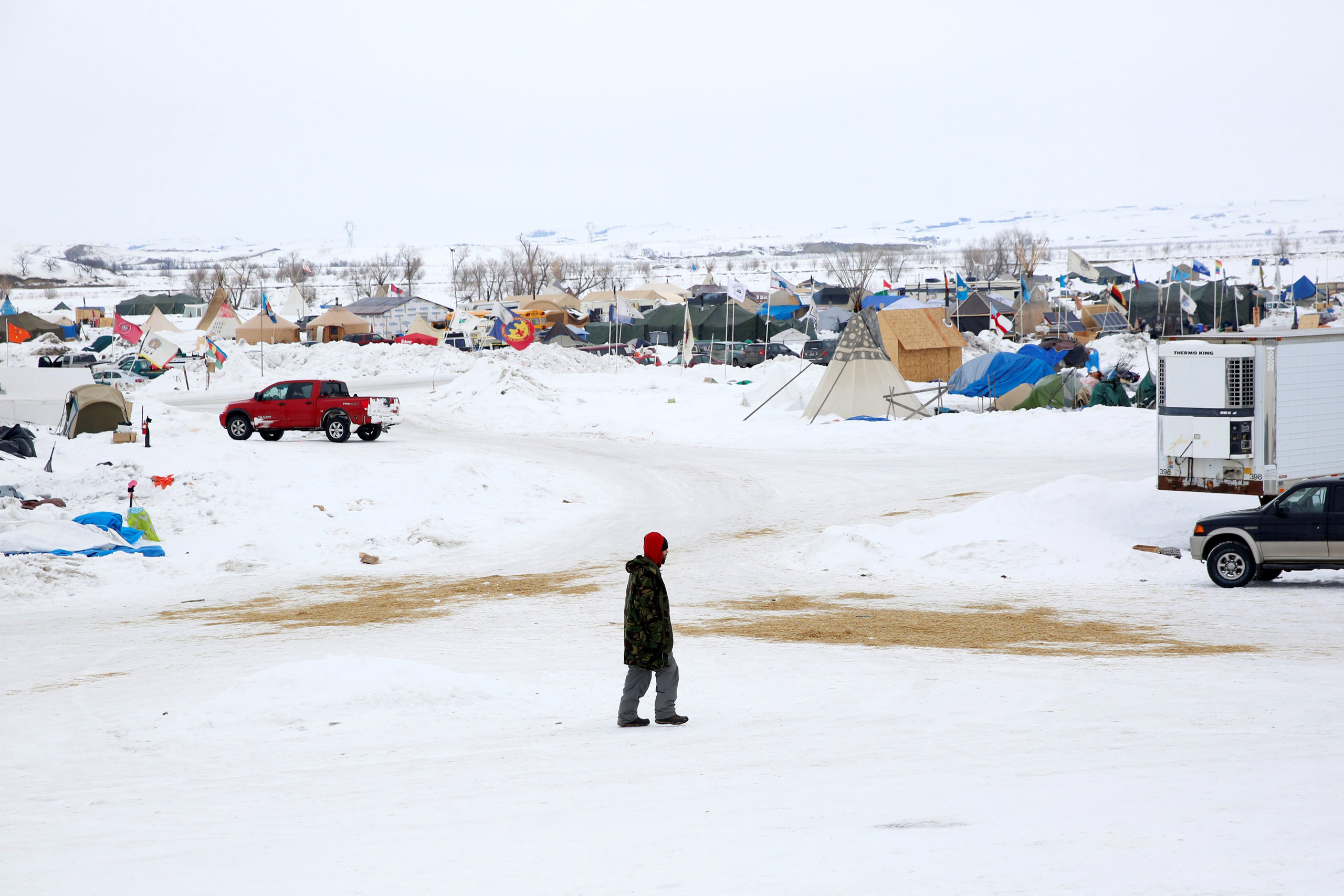 A man walks through the Dakota Access Pipeline protest camp on the edge of the Standing Rock Sioux Reservation near Cannon Ball, N.D., on Jan. 24, 2017.