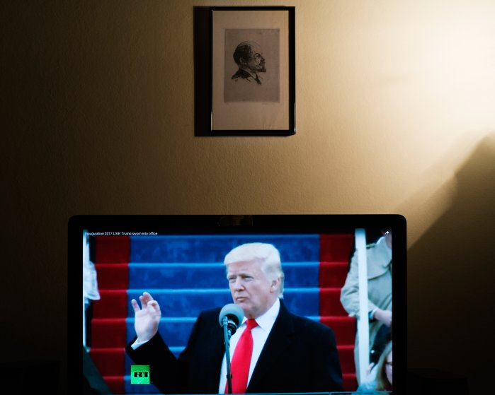Donald Trump delivers his first address as the 45th American president in a broadcast carried by Russian state television network RT on Jan. 20, 2017. A portrait of Vladimir Lenin hangs on the wall of the photographer's home.