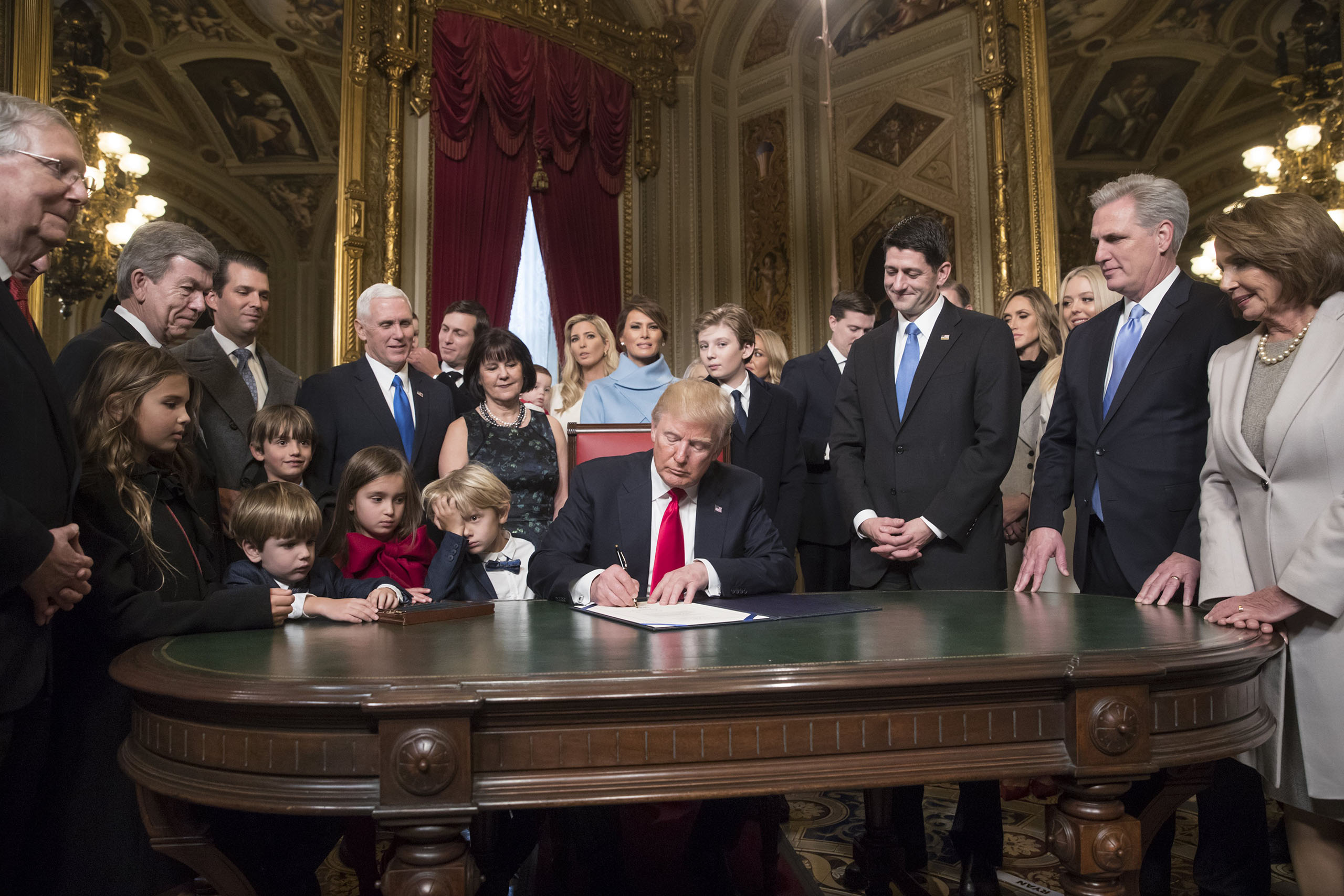 President Donald Trump is joined by the Congressional leadership and his family as he formally signs his cabinet nominations into law, in the President's Room of the Senate, at the Capitol in Washington, on Jan. 20, 2017.