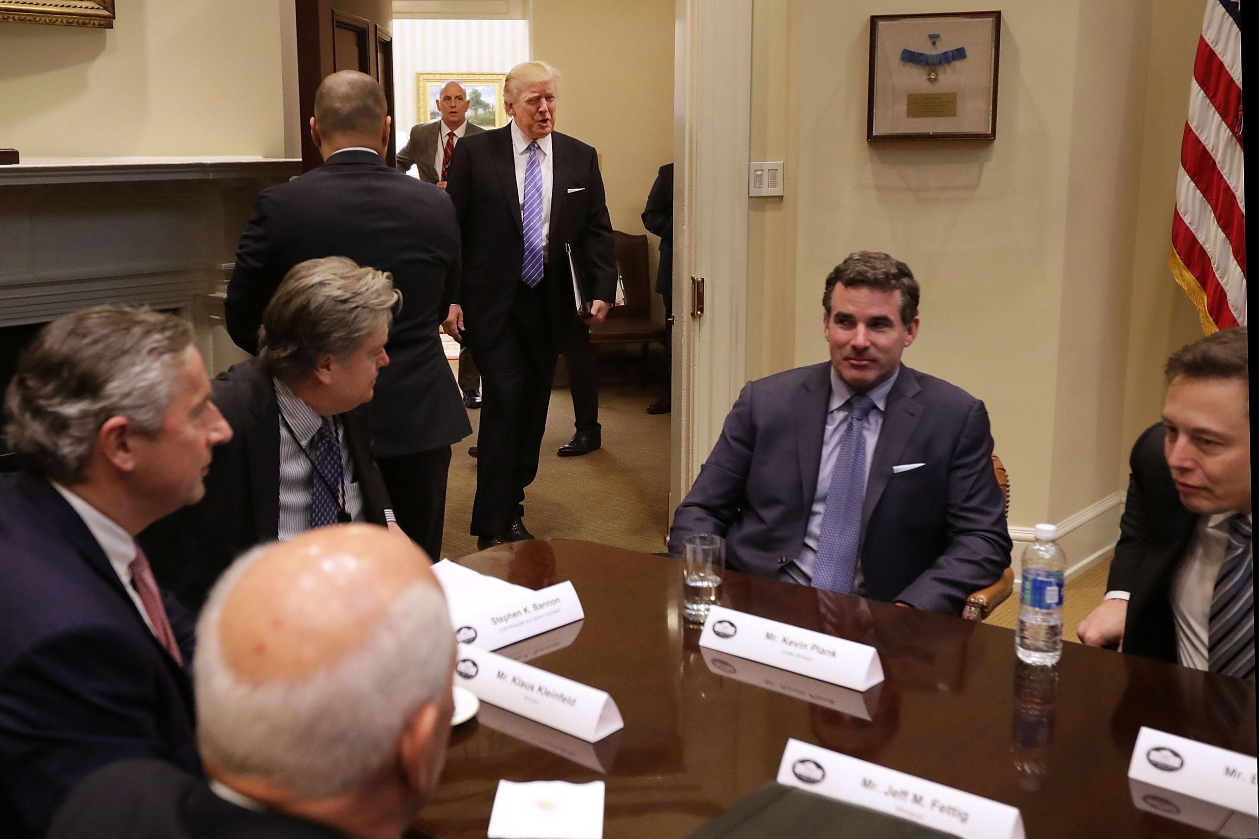 President Donald Trump walks into the Roosevelt Room for a meeting with business leaders at the White House, on Jan. 23, 2017.