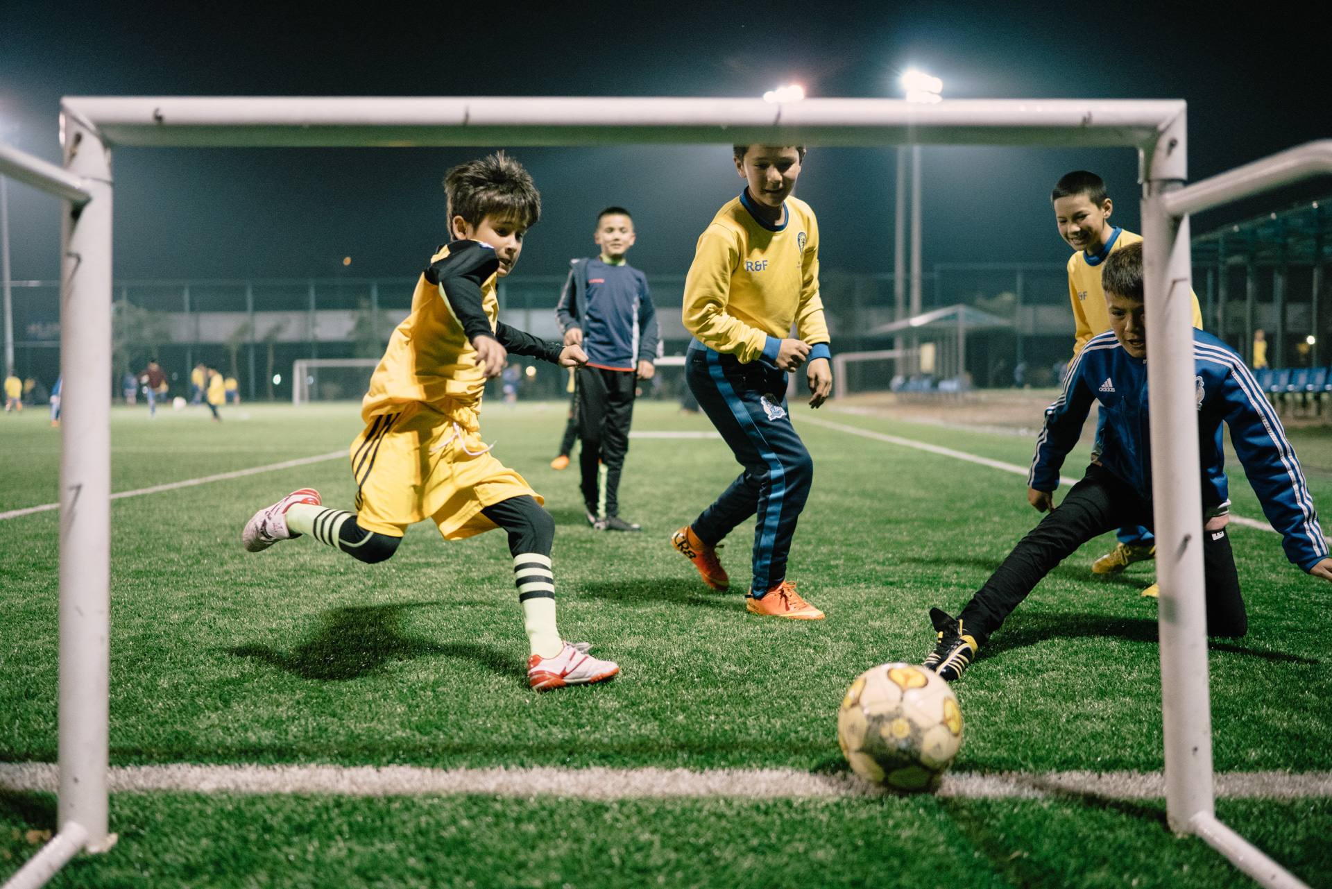 Muhammad trains at night. The Uyghur kids study in Meizhou R&F Socccer School, they usually spend about 13 hours a week training. March 17, 2016.