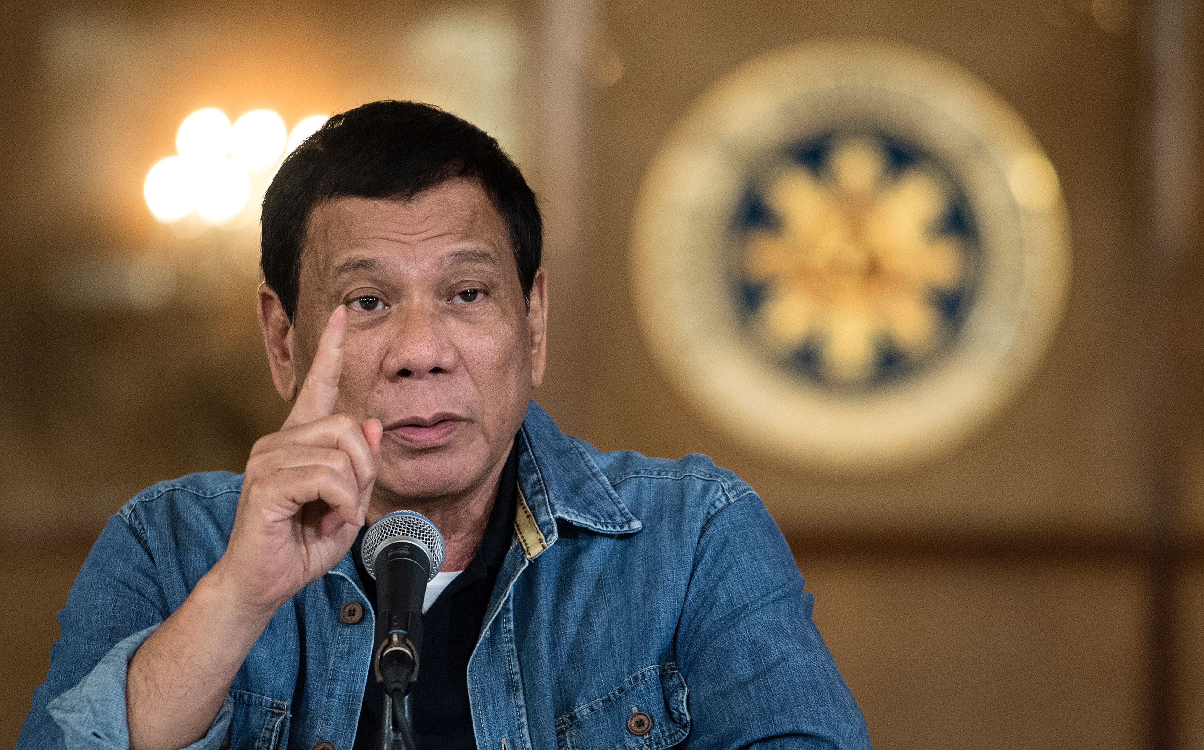Philippine's President Rodrigo Duterte gestures as he answers a question during a press conference at the Malacanang palace in Manila on January 30, 2017.