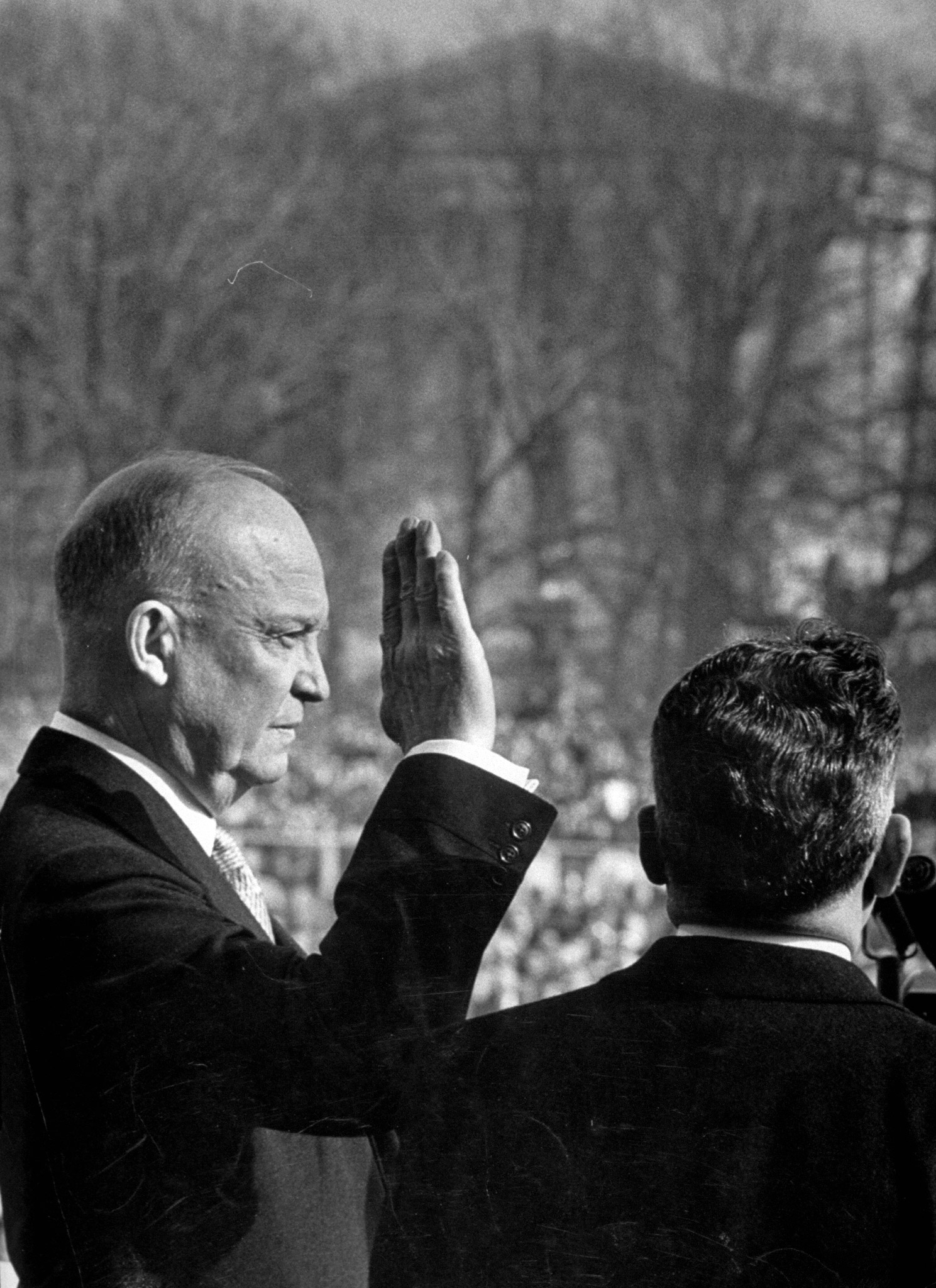 Dwight D. Eisenhower taking his first oath of office during inauguration, 1953.