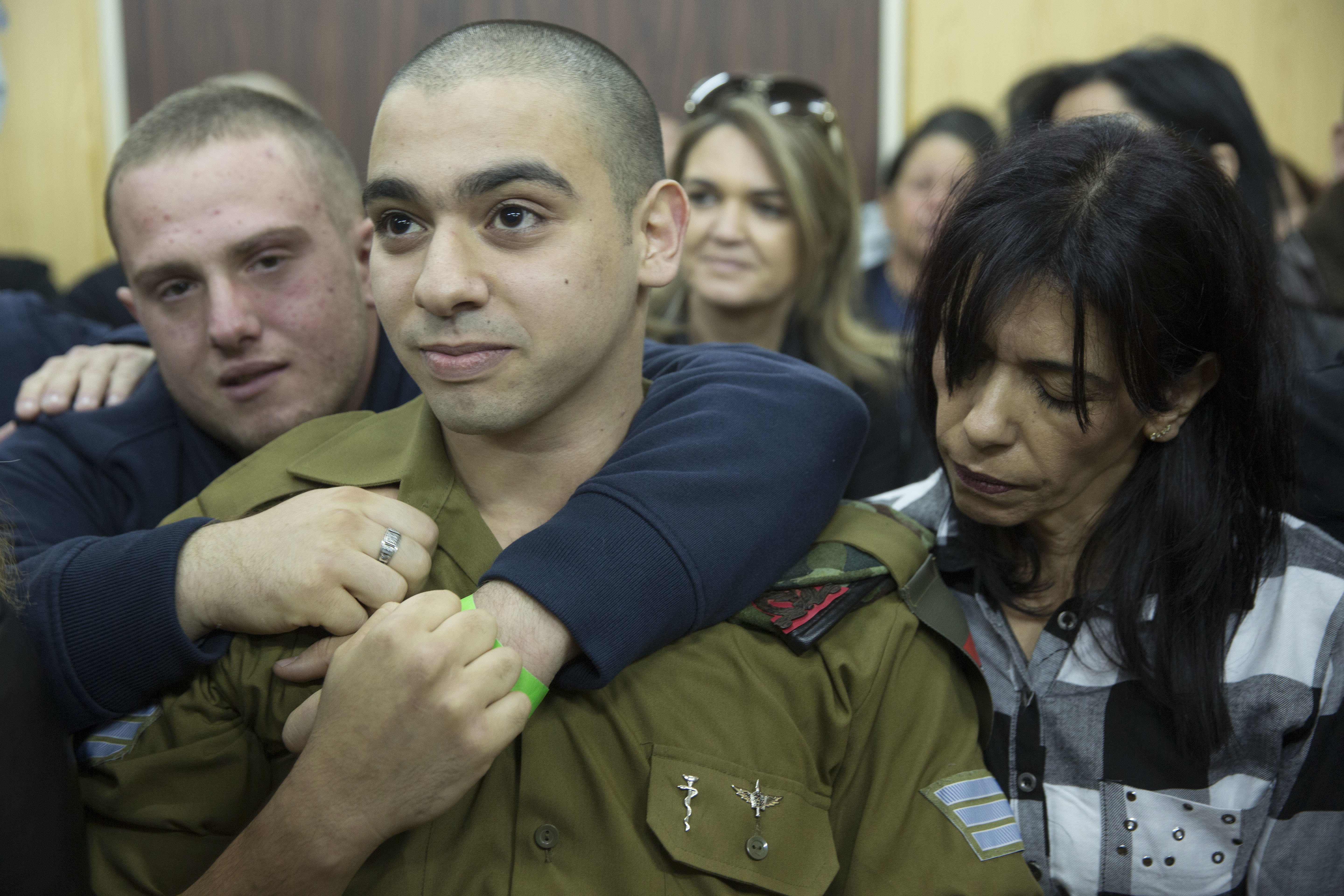 Elor Azaria waits with his parents for the verdict inside the military court in Tel Aviv, Israel, on Jan. 4, 2017.