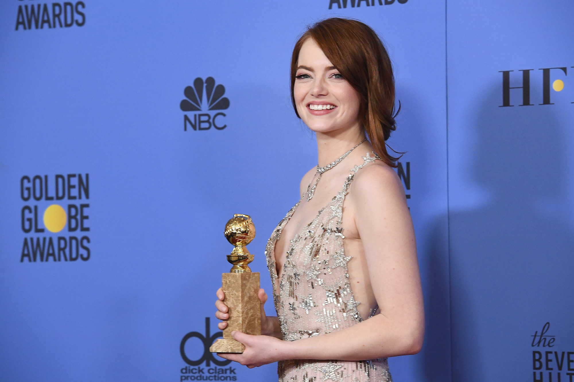 Emma Stone, winner of the Best Performance by an Actress in a Motion Picture — Comedy or Musical for 'La La Land', poses in the press room at the 74th Annual Golden Globe Awards held at the Beverly Hilton Hotel on January 8, 2017.  (Photo by Kevork Djansezian/NBC/NBCU Photo Bank via Getty Images)