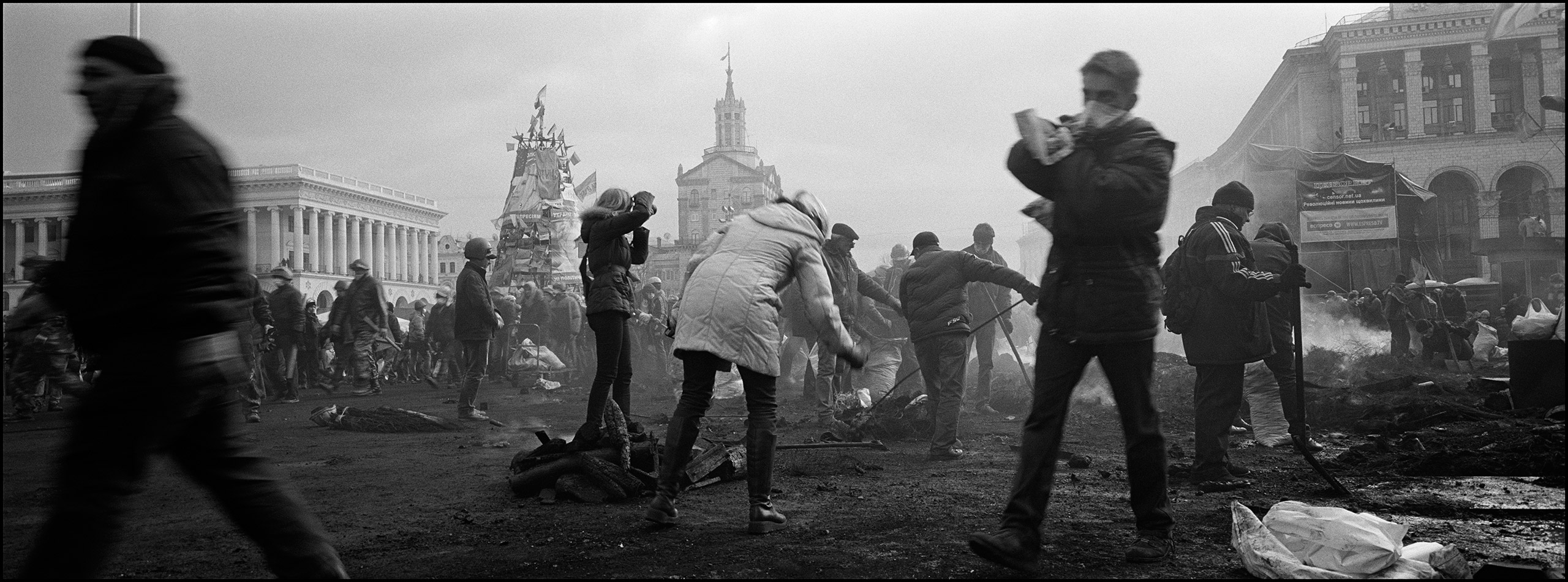 Protesters clean away debris and re-build barricades in Independence (Maidan) Square after a long night of clashes with riot police. Kiev, Ukraine, February 2014.