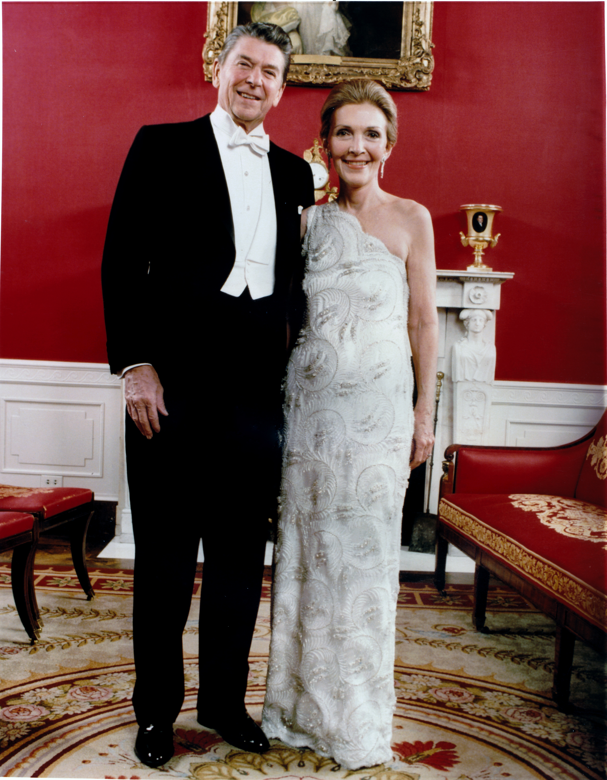 Nancy Reagan, James Galanos, 1981: The white beaded, one-shoulder dress with lace over silk satin was criticized as too lavish as the country was in the midst of a recession.