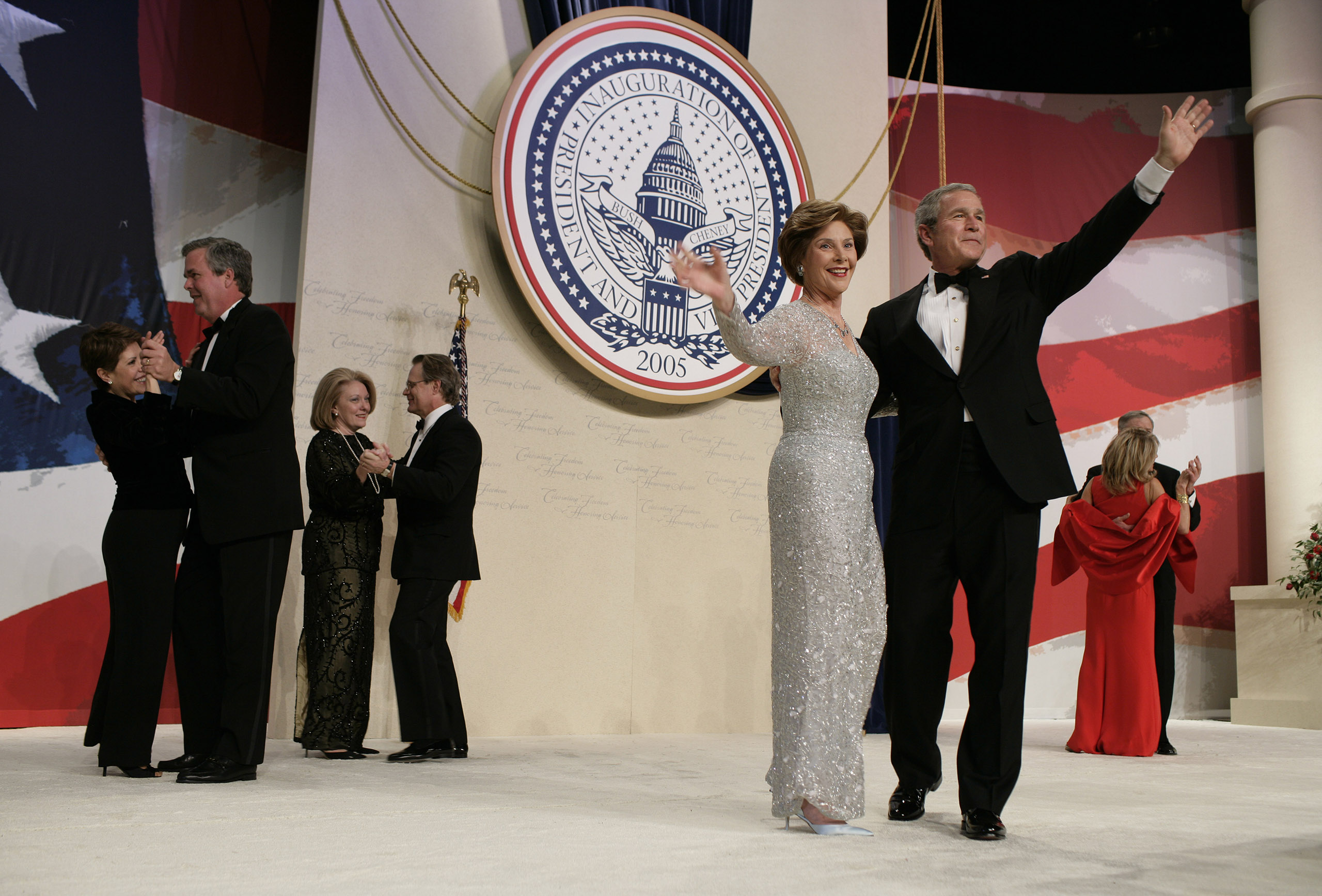 Laura Bush, Oscar de la Renta, 2005: The dress is an ice blue and silver embroidered tulle V-neck. She also wore de la Renta for a 2001 Vogue photo shoot and at the 2004 Republican National Convention.