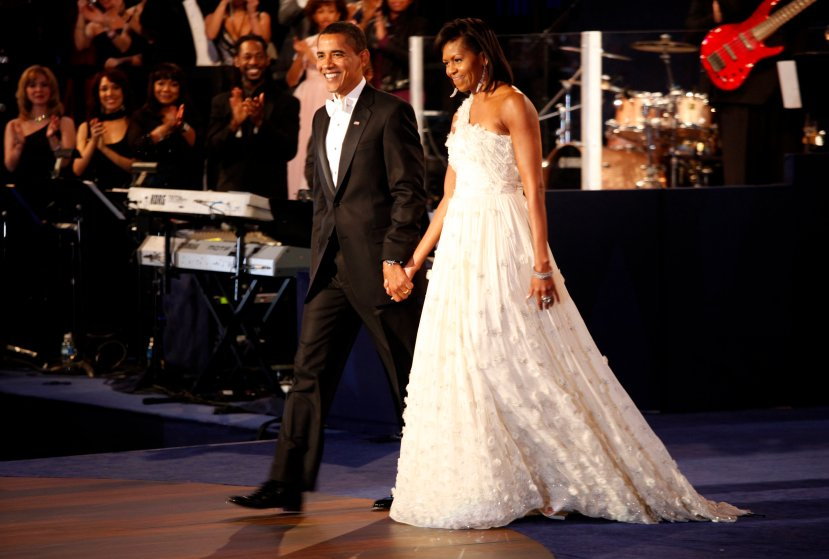 President Barack Obama and first lady Michelle arriving on stage for a dance, at the Neighborhood Inaugural Ball at the Convention Center in Washington, Tuesday, January 20, 2009.