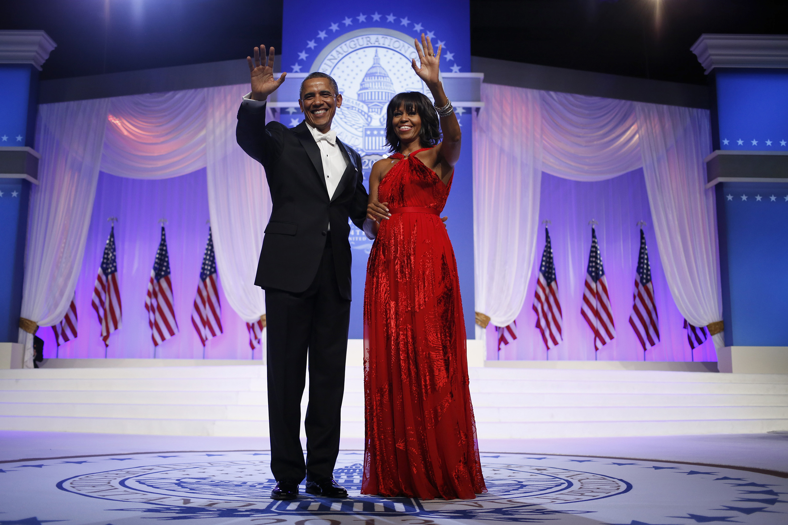Michelle Obama, Jason Wu, 2013: The sleeveless red, chiffon and velvet gown was paired with a diamond embellished ring by jewelry designer Kimberly McDonald and shoes by Jimmy Choo.