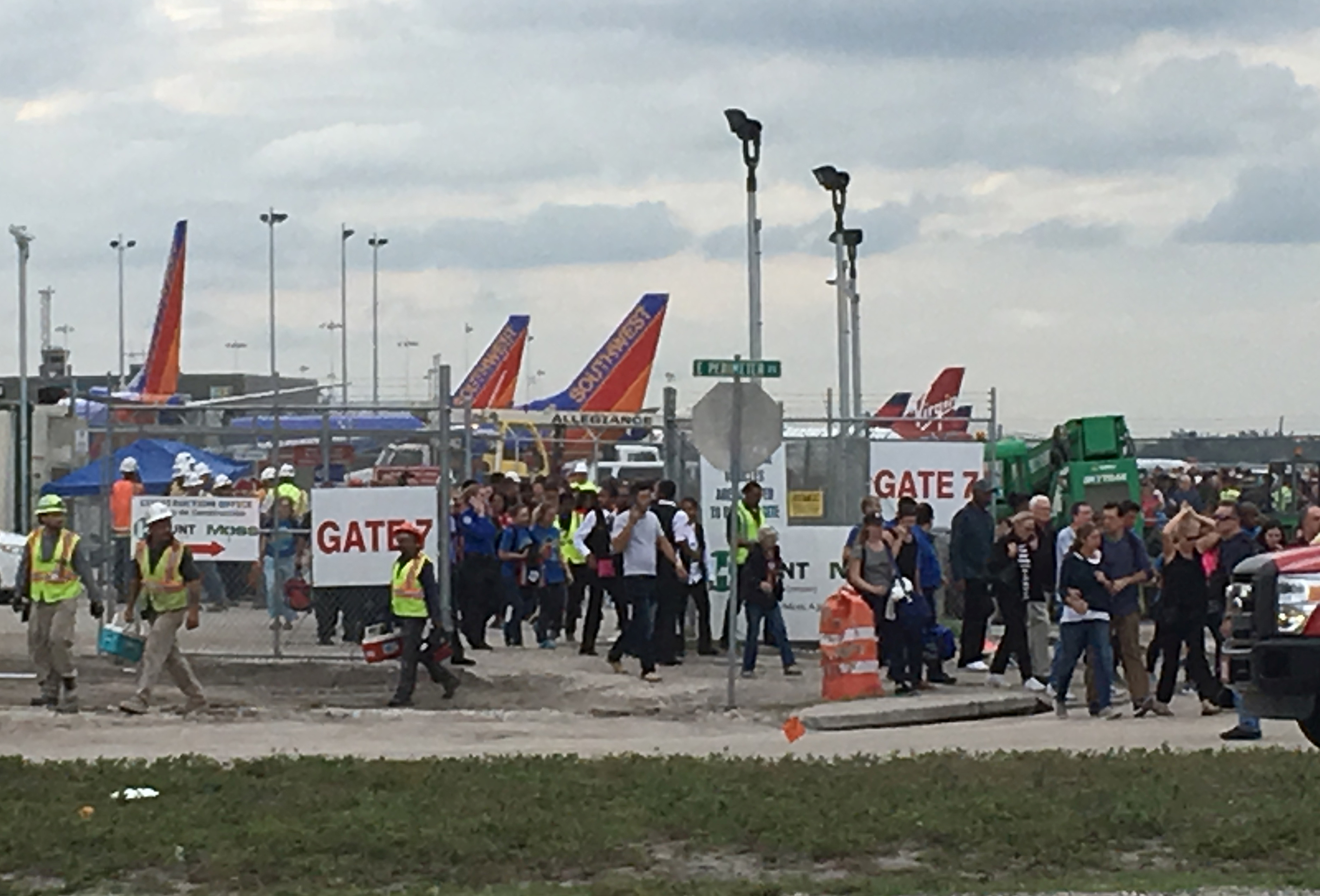 Travelers and airport workers are evacuated out of the terminal after airport shooting at Fort Lauderdale-Hollywood International Airport in Florida, Jan. 6, 2017.
