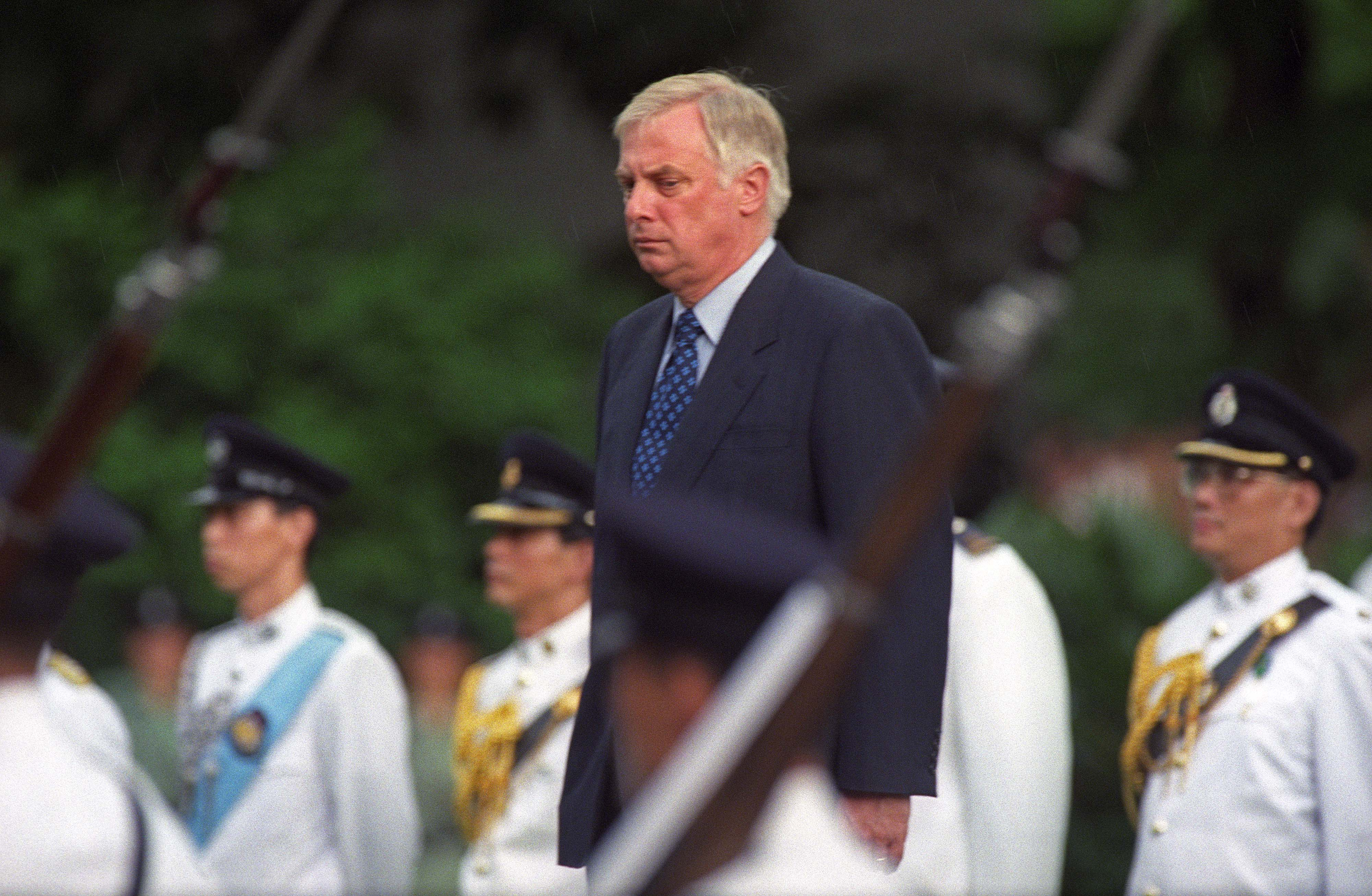 Chris Patten stands for a farewell ceremony at Hong Kong's Government House, Jun. 30, 1997.
