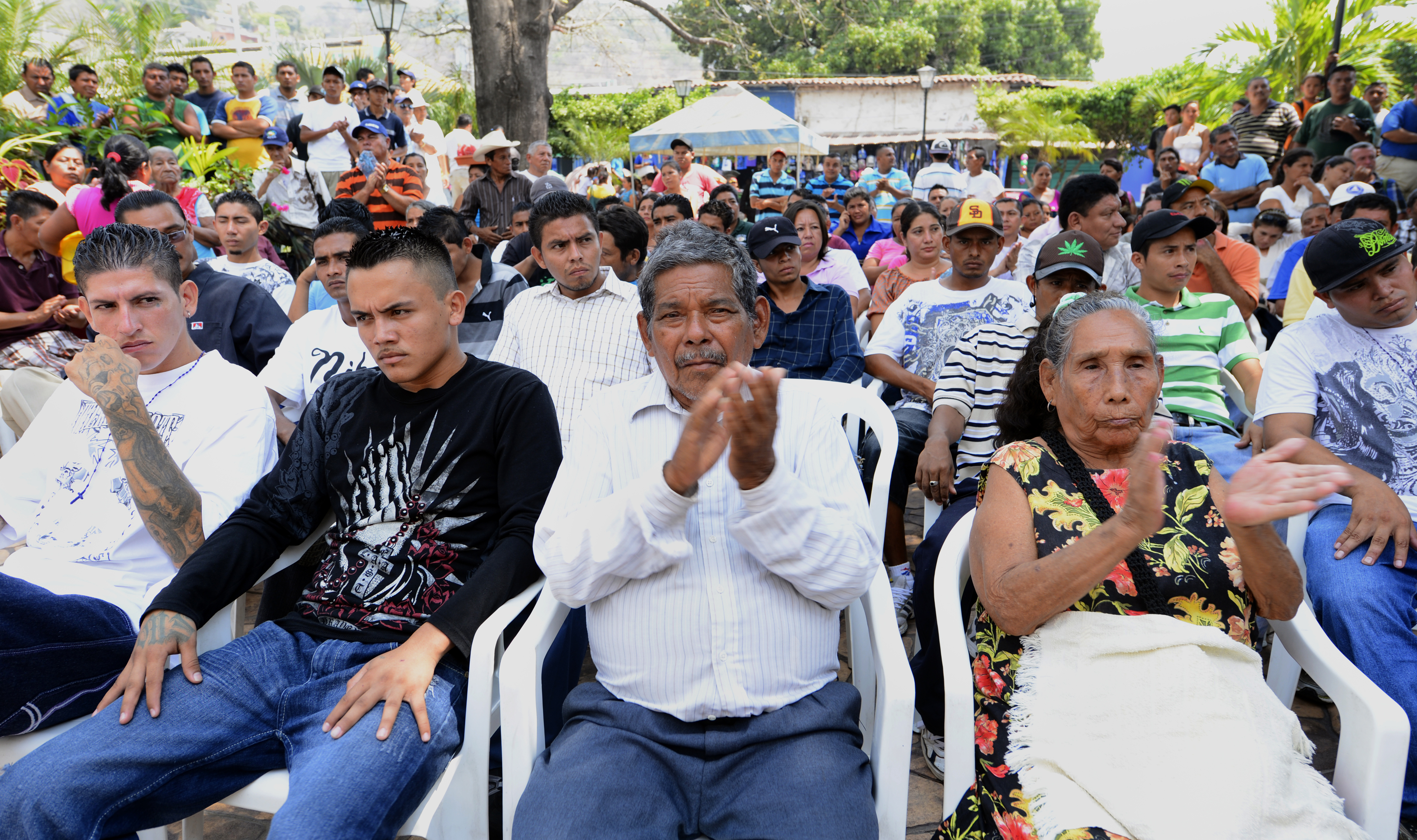 People attend a ceremony in which two feared street gangs of El Salvador signed a truce to keep the beach resort of Puerto de la Libertad free of violence, in this city about 35 km south of San Salvador, on March 1, 2013.