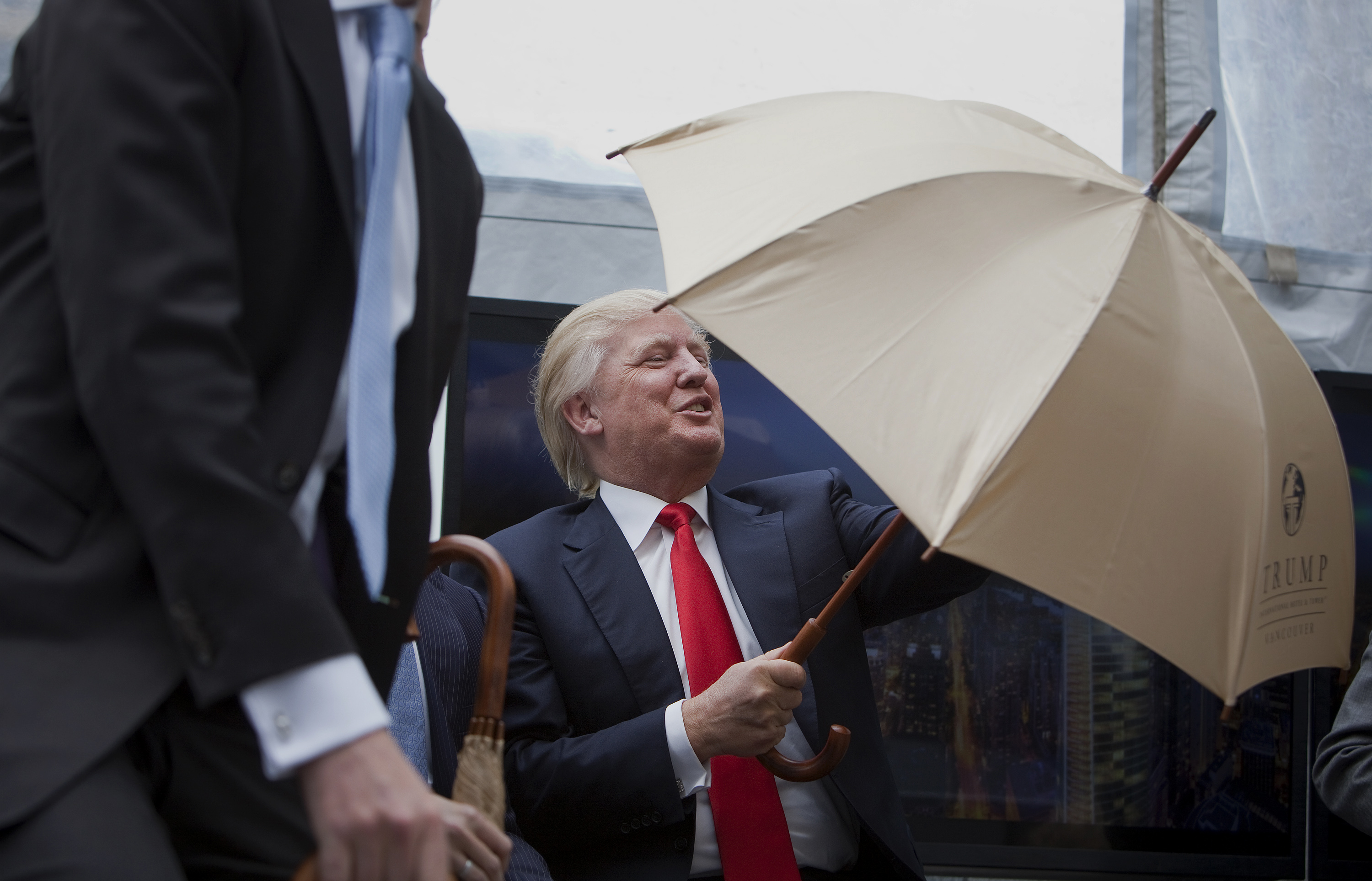 Real estate investor Donald Trump opens an umbrella while speaking at an event in Vancouver, British Columbia, Canada, on Wednesday, June 19, 2013.