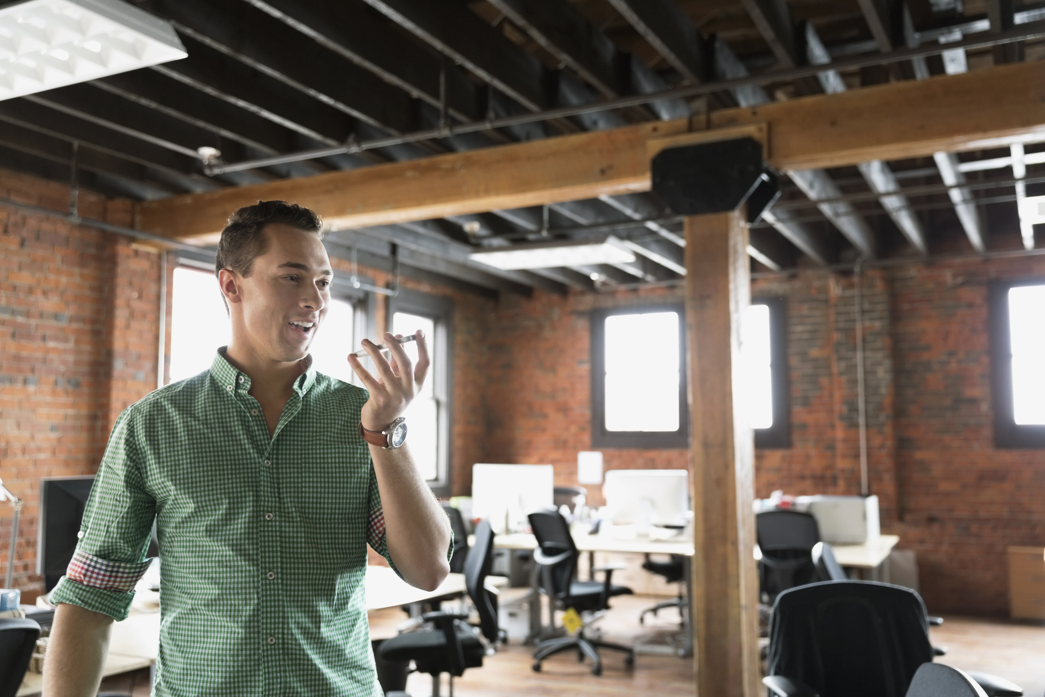 Entrepreneur talking on mobile phone in creative office space